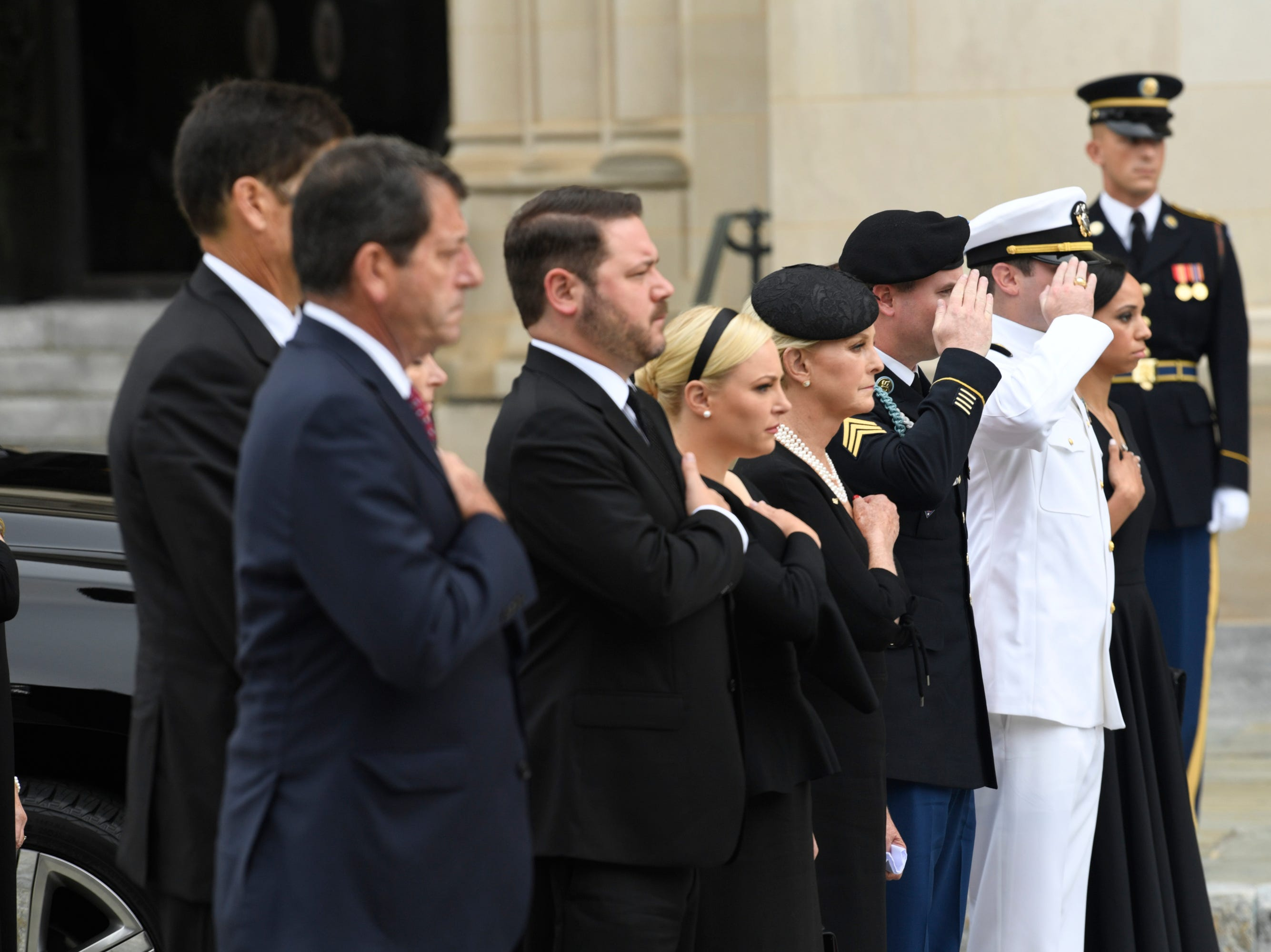 9/1/18 9:43:00 AM -- Washington, DC, U.S.A  -- Members of the McCain family leave the memorial service for John McCain at the National Cathedral in Washington on Sept. 1, 2018. --    Photo by Jasper Colt, USA TODAY Staff