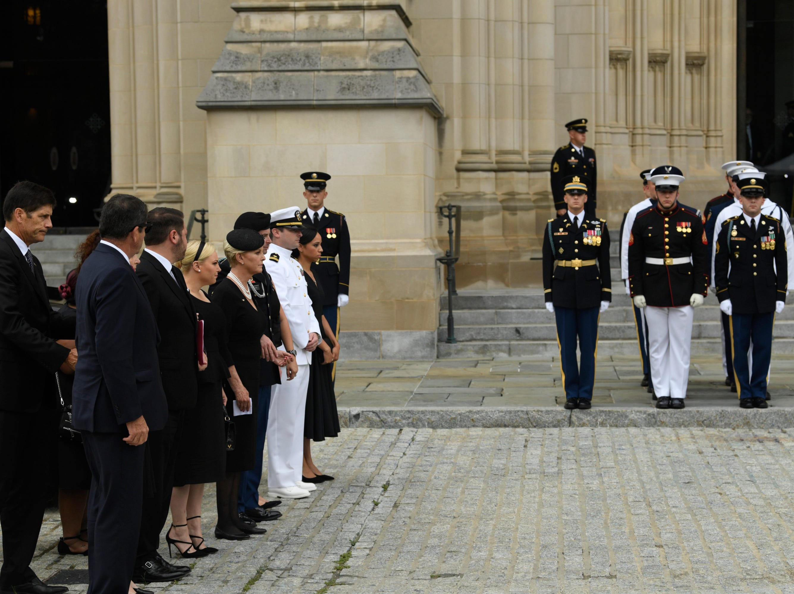9/1/18 9:41:39 AM -- Washington, DC, U.S.A  -- Members of the McCain family watch as John McCainÕs casket is carried into the National Cathedral in Washington for a memorial service on Sept. 1, 2018. Sen. McCain died on Aug. 25. --    Photo by Jasper Colt, USA TODAY Staff