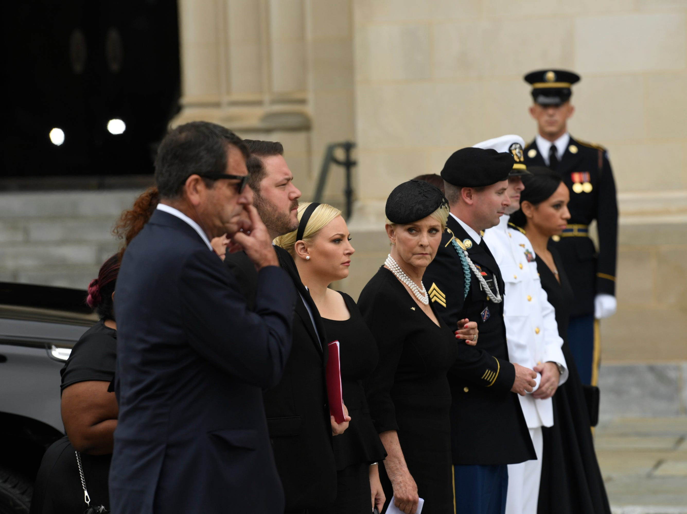 9/1/18 9:41:33 AM -- Washington, DC, U.S.A  -- Members of the McCain family watch as John McCainÕs casket is carried into the National Cathedral in Washington for a memorial service on Sept. 1, 2018. Sen. McCain died on Aug. 25. --    Photo by Jasper Colt, USA TODAY Staff