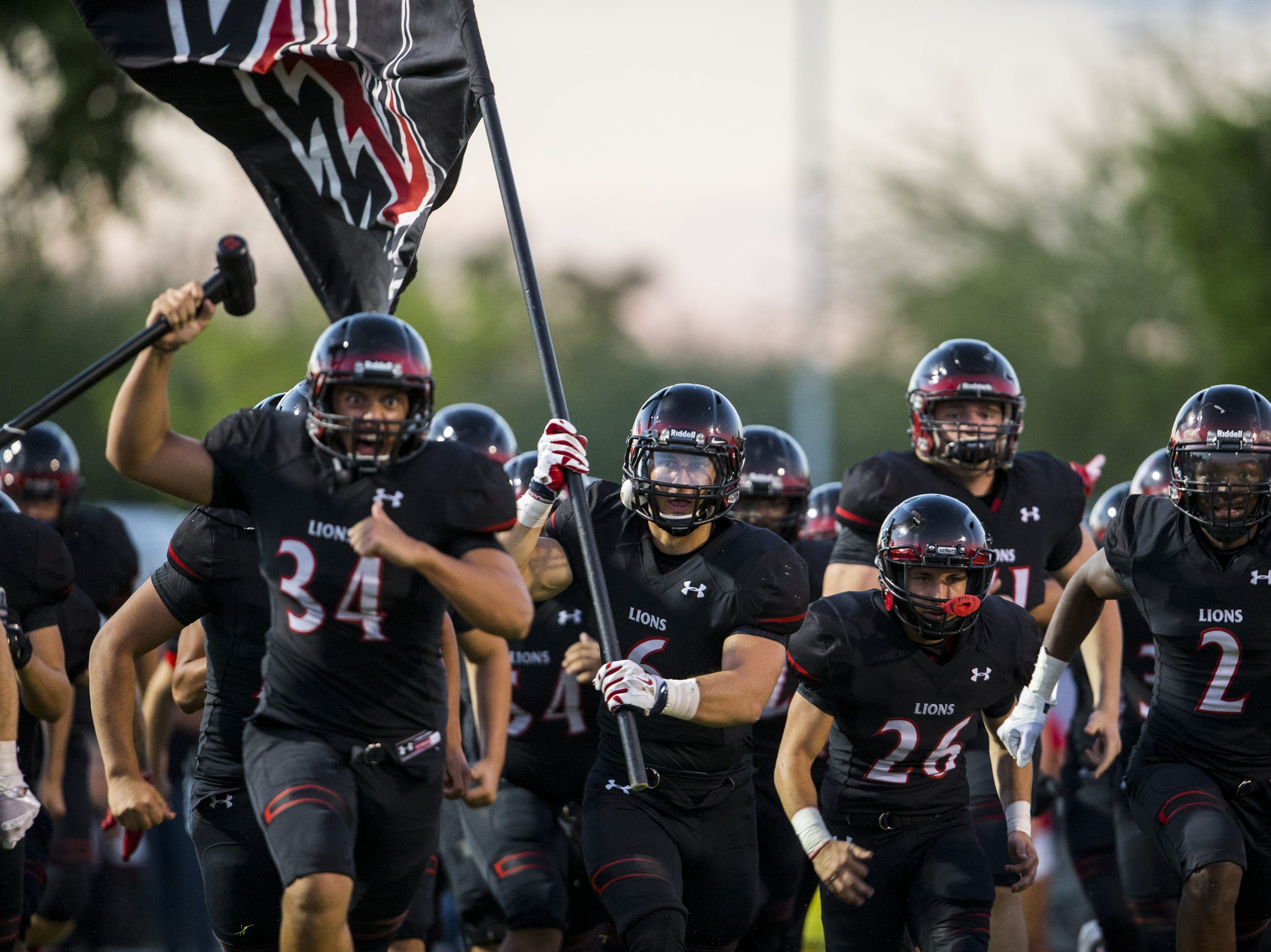 Liberty takes the field before their game against Sunrise Mountain on Friday, Aug. 31, 2018, at Liberty High School in Peoria, Ariz.  #azhsfb