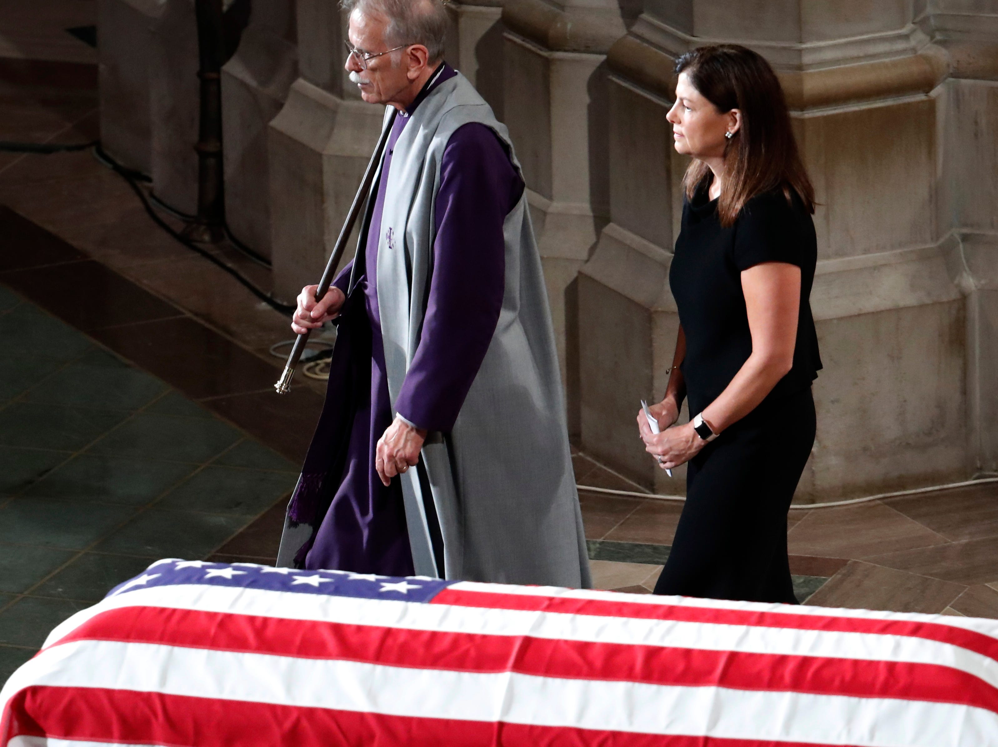 Former New Hampshire Sen. Kelly Ayotte walks after reading scripture at a memorial service for Sen. John McCain, R-Ariz., at Washington National Cathedral in Washington, Saturday, Sept. 1, 2018. McCain died Aug. 25, from brain cancer at age 81. (AP Photo/Pablo Martinez Monsivais)