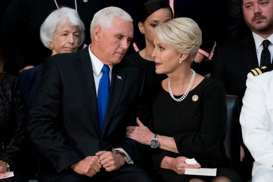 Cindy McCain, wife of Sen. John McCain, R-Ariz., right, talks with Vice President Mike Pence, left, after he speaks at a ceremony for John McCain as he lies in state in the Rotunda of the U.S. Capitol, Friday, Aug. 31, 2018, in Washington.