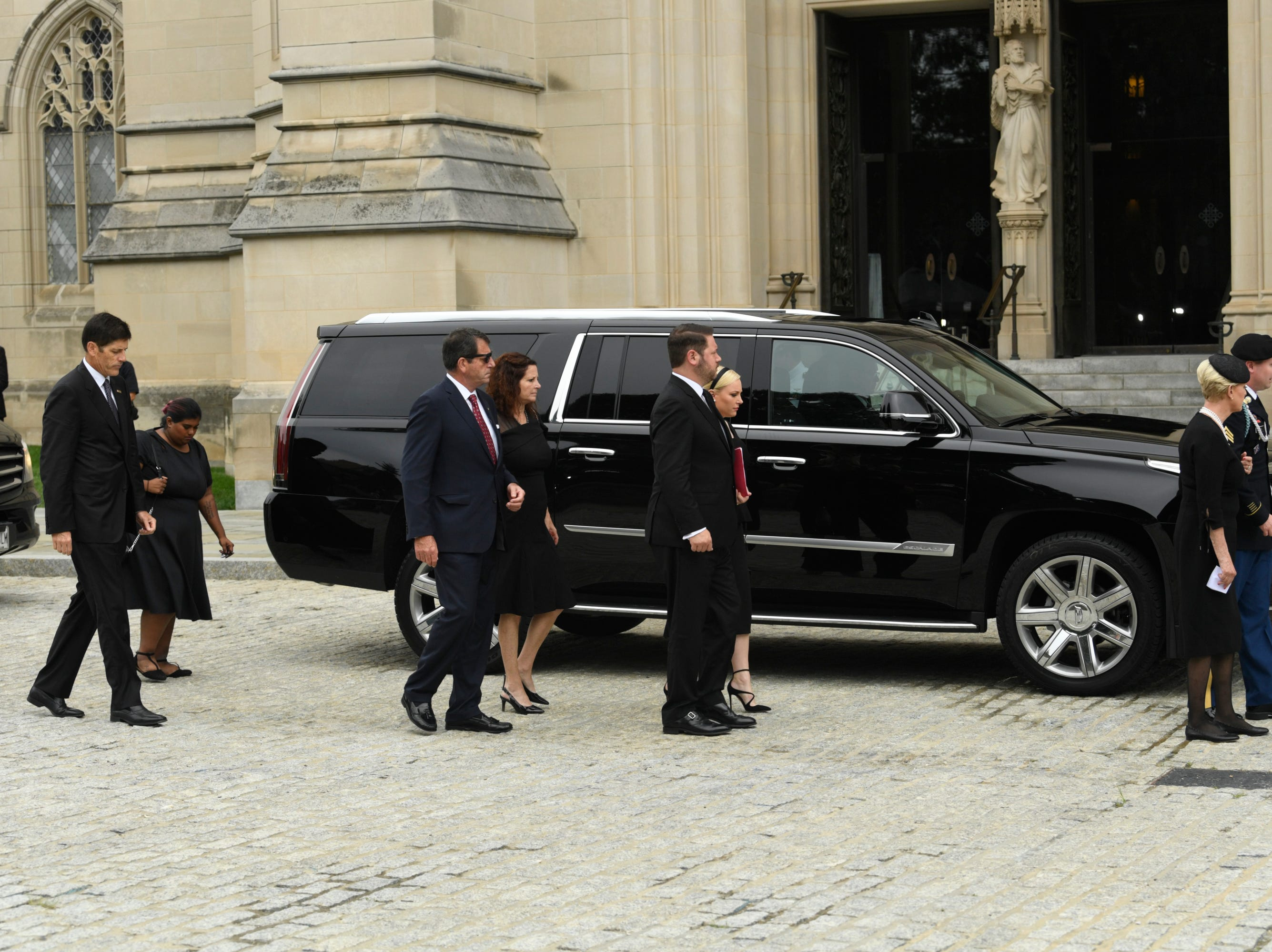 9/1/18 9:41:10 AM -- Washington, DC, U.S.A  -- The McCain family arrives at the National Cathedral in Washington for a memorial service for John McCain on Sept. 1, 2018. Sen. McCain on Aug. 25. McCain died on Aug. 25. --    Photo by Jasper Colt, USA TODAY Staff