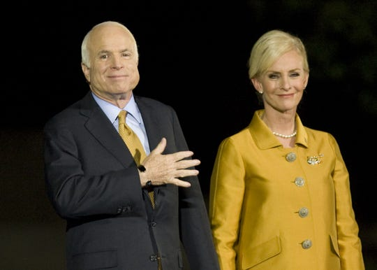 Republican presidential candidate Sen. John McCain with his wife, Cindy, at his side, acknowledges his supporters after giving his concession speech at the Arizona Biltmore Resort in Phoenix on Nov. 4, 2008.