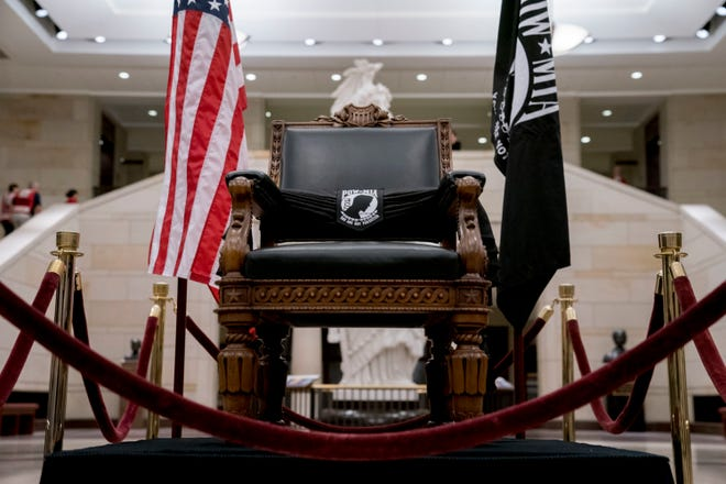 The POW/MIA Chair of Honor is displayed in the Capitol Visitors Center as Sen. John McCain, R-Ariz., lies in state in the Rotunda of the U.S. Capitol, Friday, Aug. 31, 2018, in Washington.