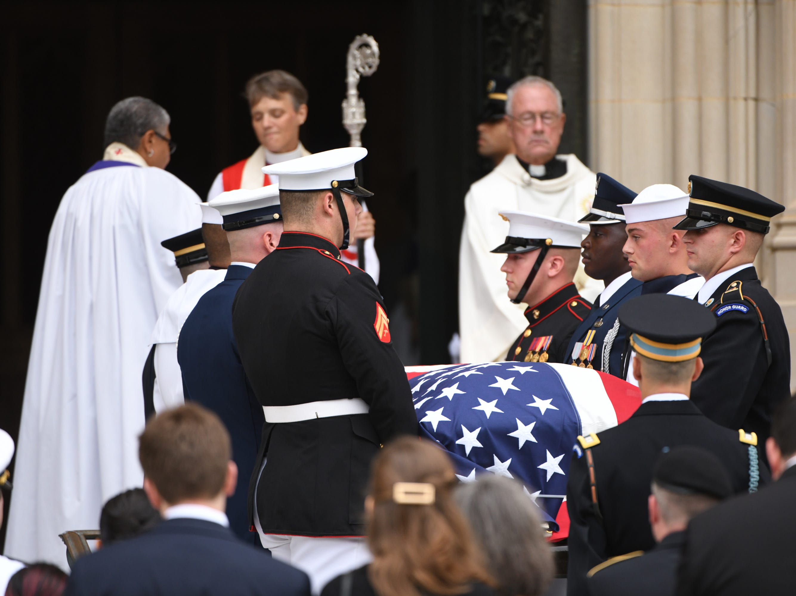 9/1/18 9:47:18 AM -- Washington, DC, U.S.A  -- Members of the McCain family watch as John McCainÕs casket is carried into the National Cathedral in Washington for a memorial service on Sept. 1, 2018. Sen. McCain died on Aug. 25. --    Photo by Jasper Colt, USA TODAY Staff