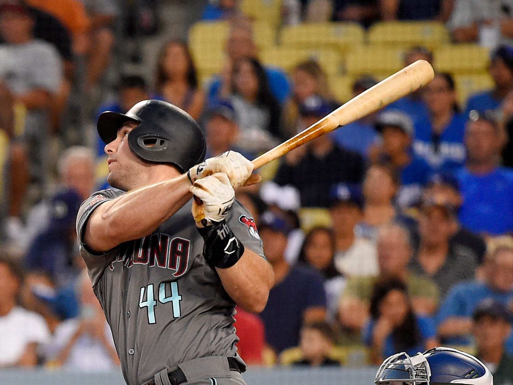 Arizona Diamondbacks' Paul Goldschmidt hits a two-run home run during the first inning of a baseball game against the Los Angeles Dodgers, Friday, Aug. 31, 2018, in Los Angeles.