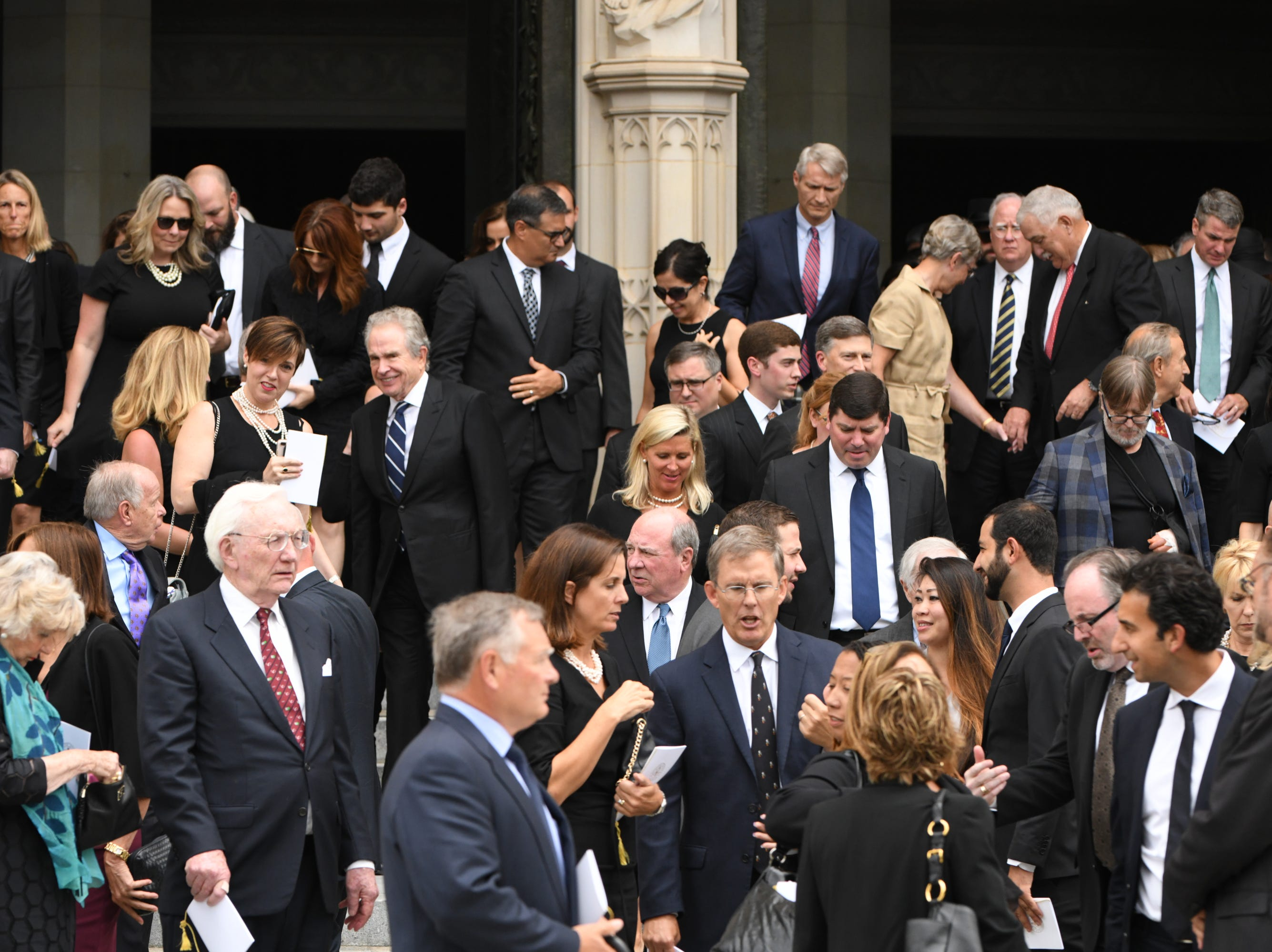 9/1/18 12:46:22 PM -- Washington, DC, U.S.A  -- Mourners leave the memorial service for John McCain at the National Cathedral in Washington on Sept. 1, 2018. Sen. McCain died on Aug. 25. --    Photo by Jasper Colt, USA TODAY Staff