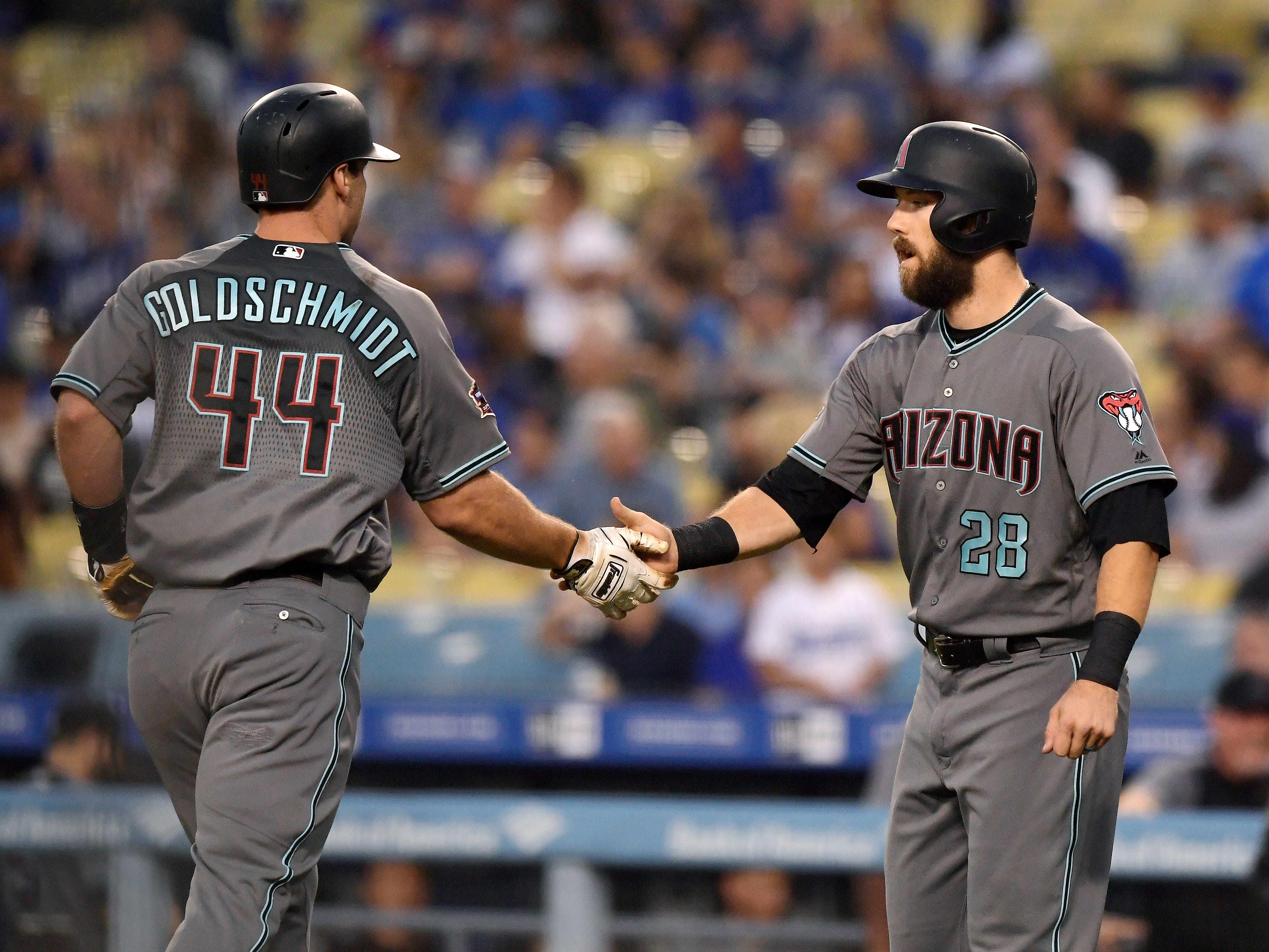 Arizona Diamondbacks' Paul Goldschmidt, left, is congratulated by Steven Souza Jr. after hitting a two-run home run during the first inning of a baseball game against the Los Angeles Dodgers, Friday, Aug. 31, 2018, in Los Angeles.