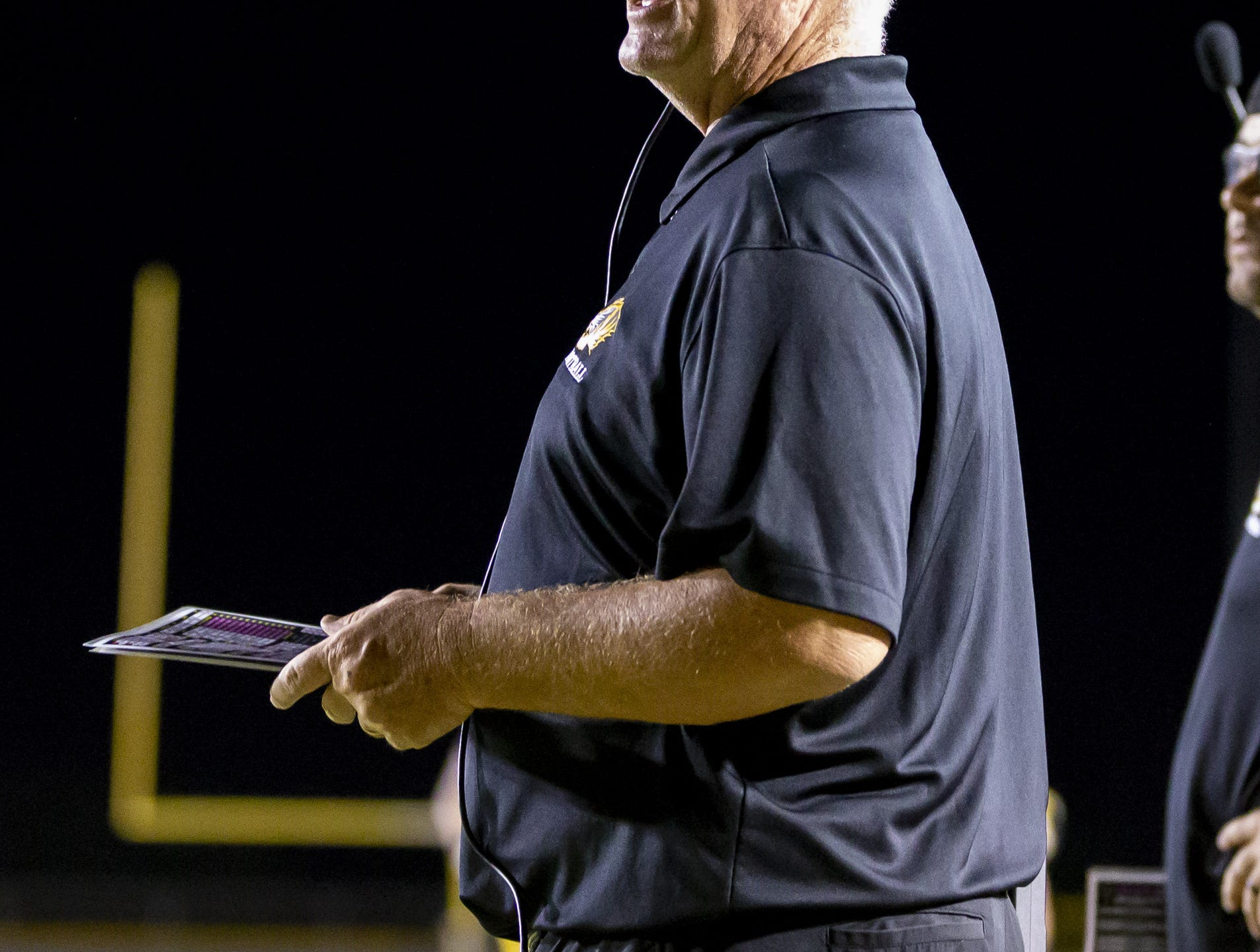 Head coach Derek Zellner of the Gilbert Tigers stands during the game against the Notre Dame Prep Saints  at Gilbert High School on Friday, Aug. 31, 2018 in Gilbert, Arizona.