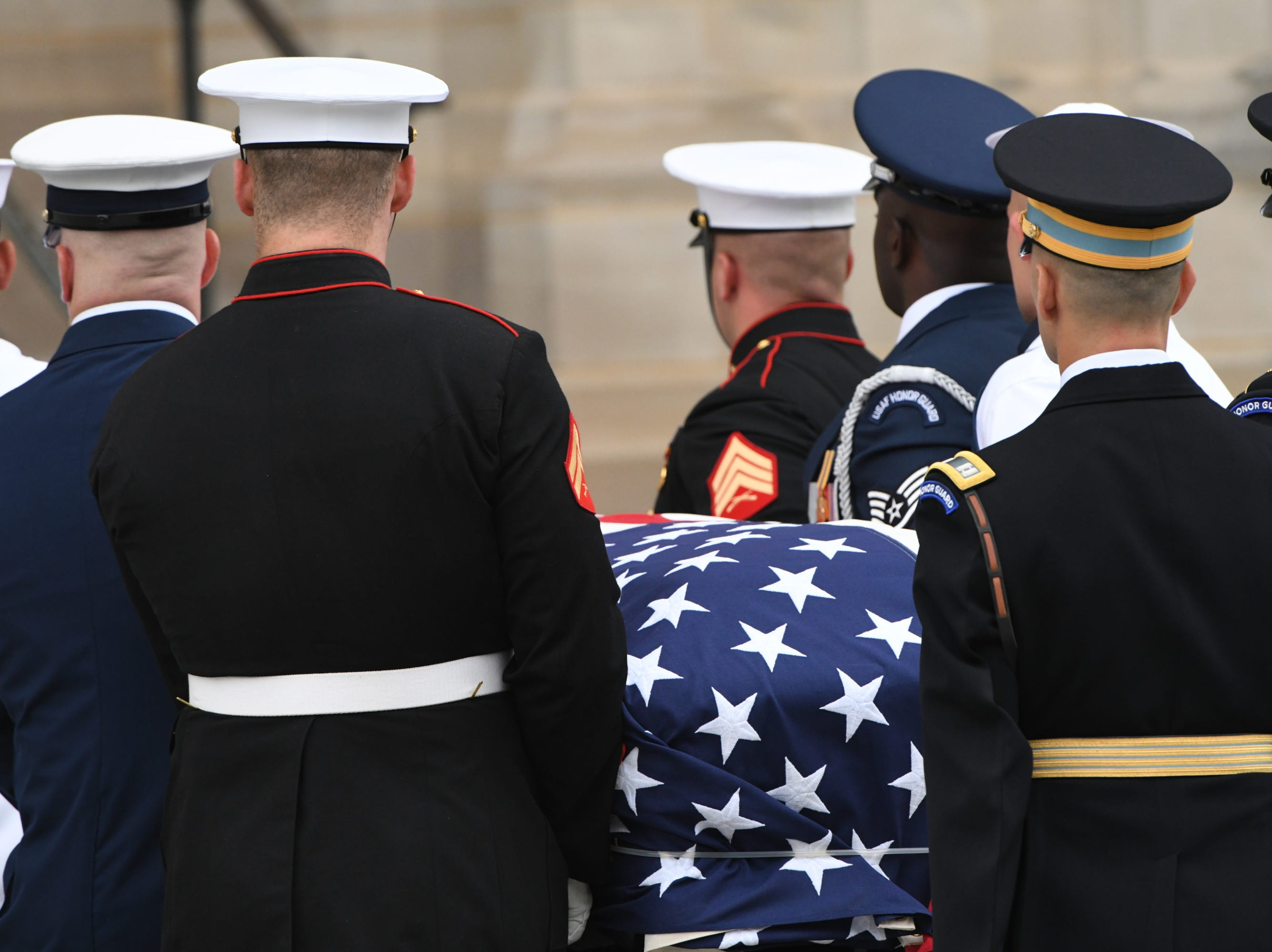 9/1/18 9:44:21 AM -- Washington, DC, U.S.A  -- The body of John McCain is carried into the National Cathedral in Washington for a memorial service on Sept. 1, 2018. Sen. McCain on Aug. 25. --    Photo by Jasper Colt, USA TODAY Staff