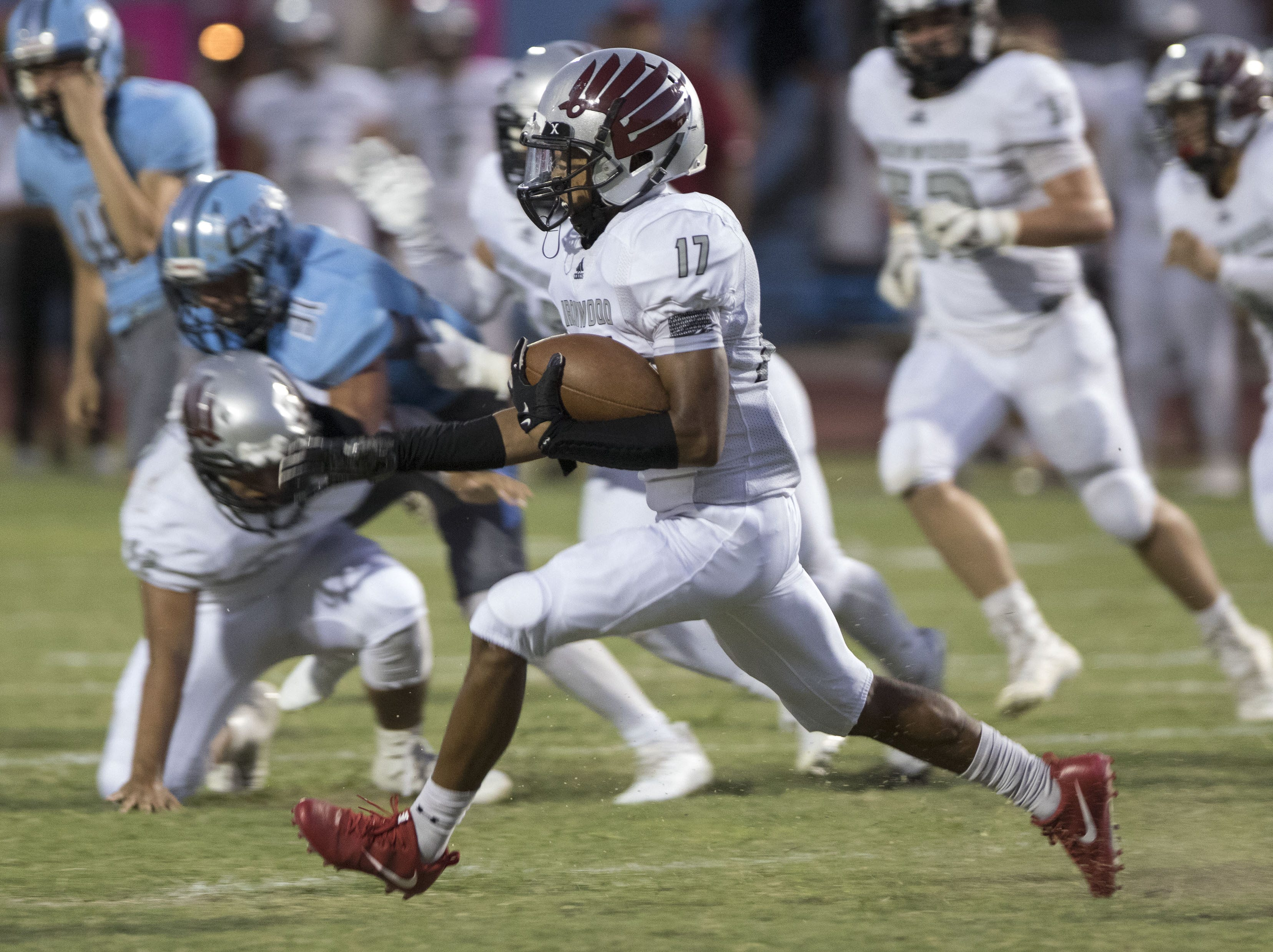 Ironwood's Alex Panduro finds running room against Cactus during their game in Glendale Friday, Aug. 31, 2018.