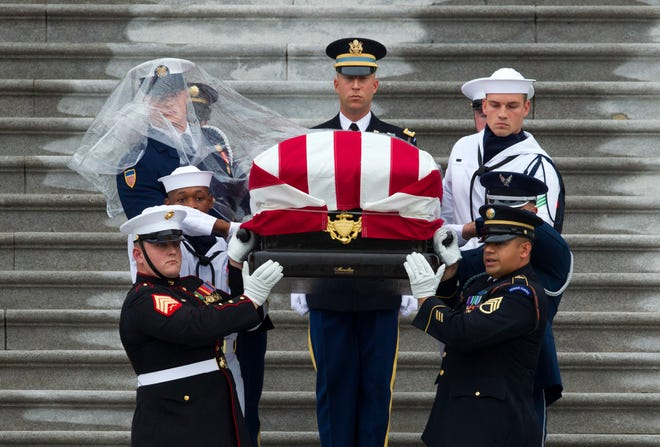 The flag-draped casket of Sen. John McCain, R-Ariz., is carried by an Armed Forces body bearer team, down the steps of the U.S. Capitol, Saturday, Sept. 1, 2018, in Washington. (AP Photo/Jose Luis Magana)