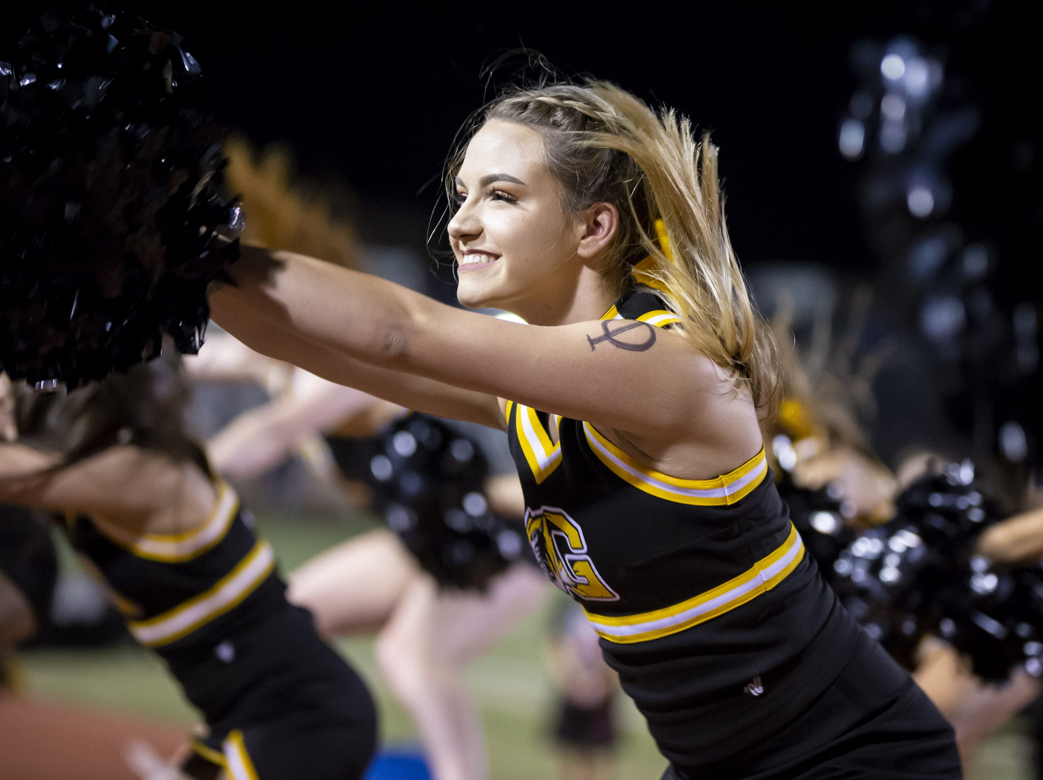 Senior cheerleader Julia Ruppel cheers during the game against the Notre Dame Prep Saints at Gilbert High School on Friday, August 31, 2018 in Gilbert, Arizona.