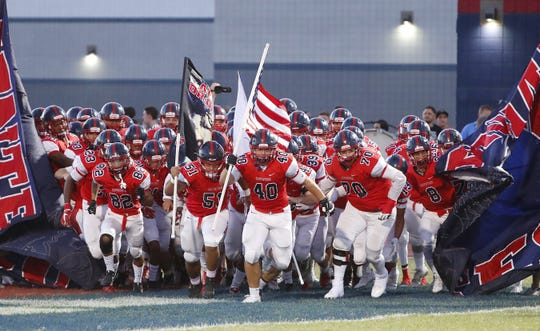 Centennial's Derek Jodarski (40) leads the team onto the field to play Bishop Gorman during a game at Centennial High School in  Peoria, Ariz. on Aug. 31, 2018.