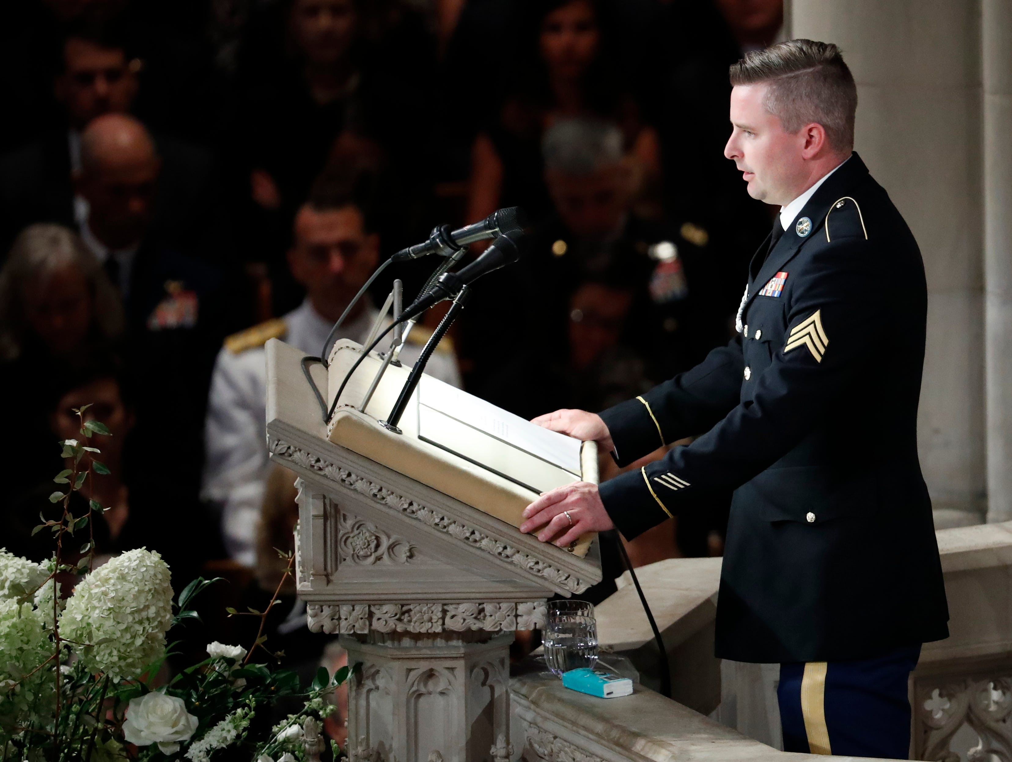 "Jimmy McCain reads the poem ""The Requiem,"" at a memorial service for his father, Sen. John McCain, R-Ariz., at Washington Nationals Cathedral in Washington, Saturday, Sept. 1, 2018. McCain died Aug. 25, from brain cancer at age 81. (AP Photo/Pablo Martinez Monsivais)"