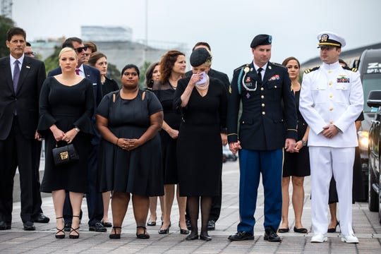 The family of Sen. John McCain, R-Ariz., including from left, Andrew McCain, Doug McCain, Meghan McCain,  Bridget McCain, Cindy McCain, Jimmy McCain and Jack McCain, watch as the casket is carried down the steps of the U.S. Capitol in Washington, Saturday, Sept. 1, 2018, in Washington, for a departure to the Washington National Cathedral for a memorial service.   (Jim Lo Scalzo/Pool photo via AP)