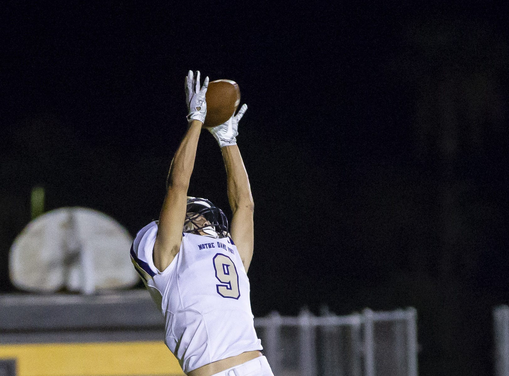 Senior wide receiver Zack Gray (9) of the Notre Dame Prep Saints attempts a catch against the Gilbert Tigers at Gilbert High School on Friday, Aug. 31, 2018, in Gilbert, Arizona.