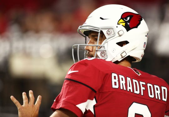 Arizona Cardinals quarterback Sam Bradford warms-up before playing the L.A. Chargers during a preseason NFL football game on Aug. 11, 2018 at University of Phoenix Stadium in Glendale, Ariz.