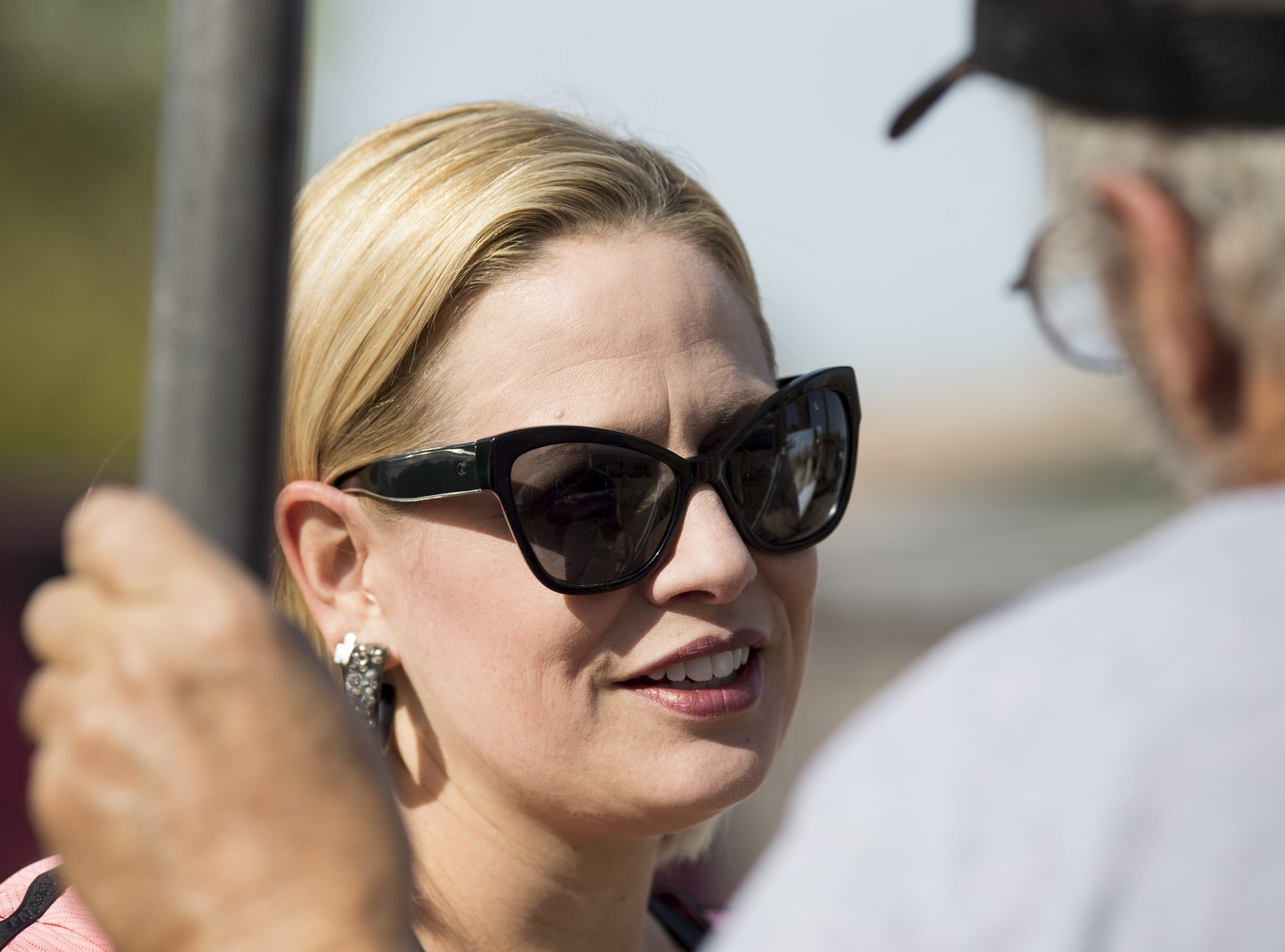 Kyrsten Sinema (left) talks with Edward Mezes  Nov. 21, 2017, in Tempe. She was participating in a Habitat for Humanity Neighborhood Revitalization Program project.
