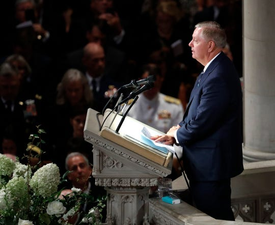 Sen. Lindsey Graham, R-S.C., reads scripture at a memorial service for Sen. John McCain, R-Ariz., at Washington National Cathedral in Washington, Saturday, Sept. 1, 2018. McCain died Aug. 25, from brain cancer at age 81. (AP Photo/Pablo Martinez Monsivais)