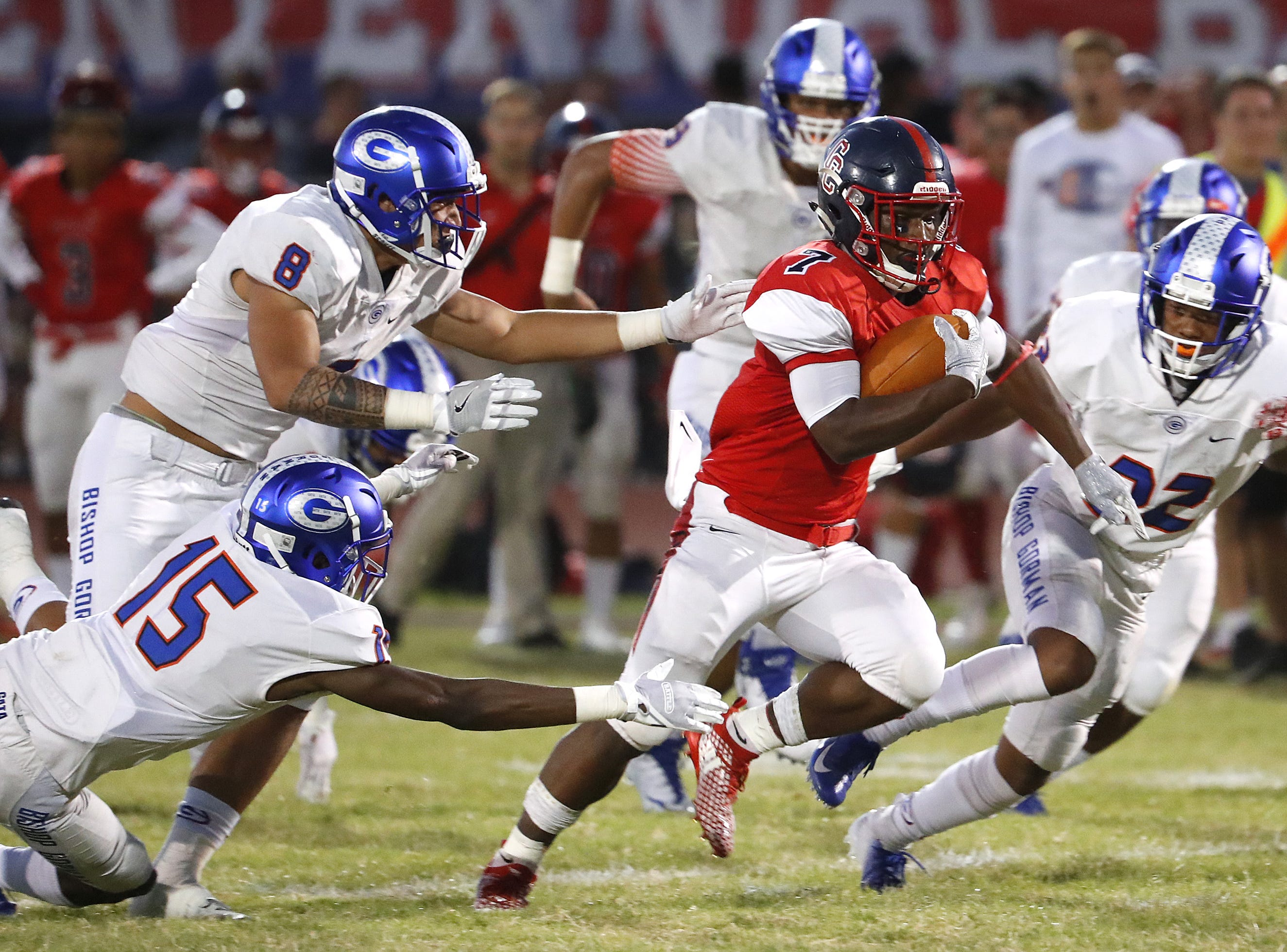 Bishop Gorman's Treven Ma'ae (8) tackles Centennial's Tawee Walker (7) during a game at Centennial High School in  Peoria, Ariz. on Aug. 31, 2018.