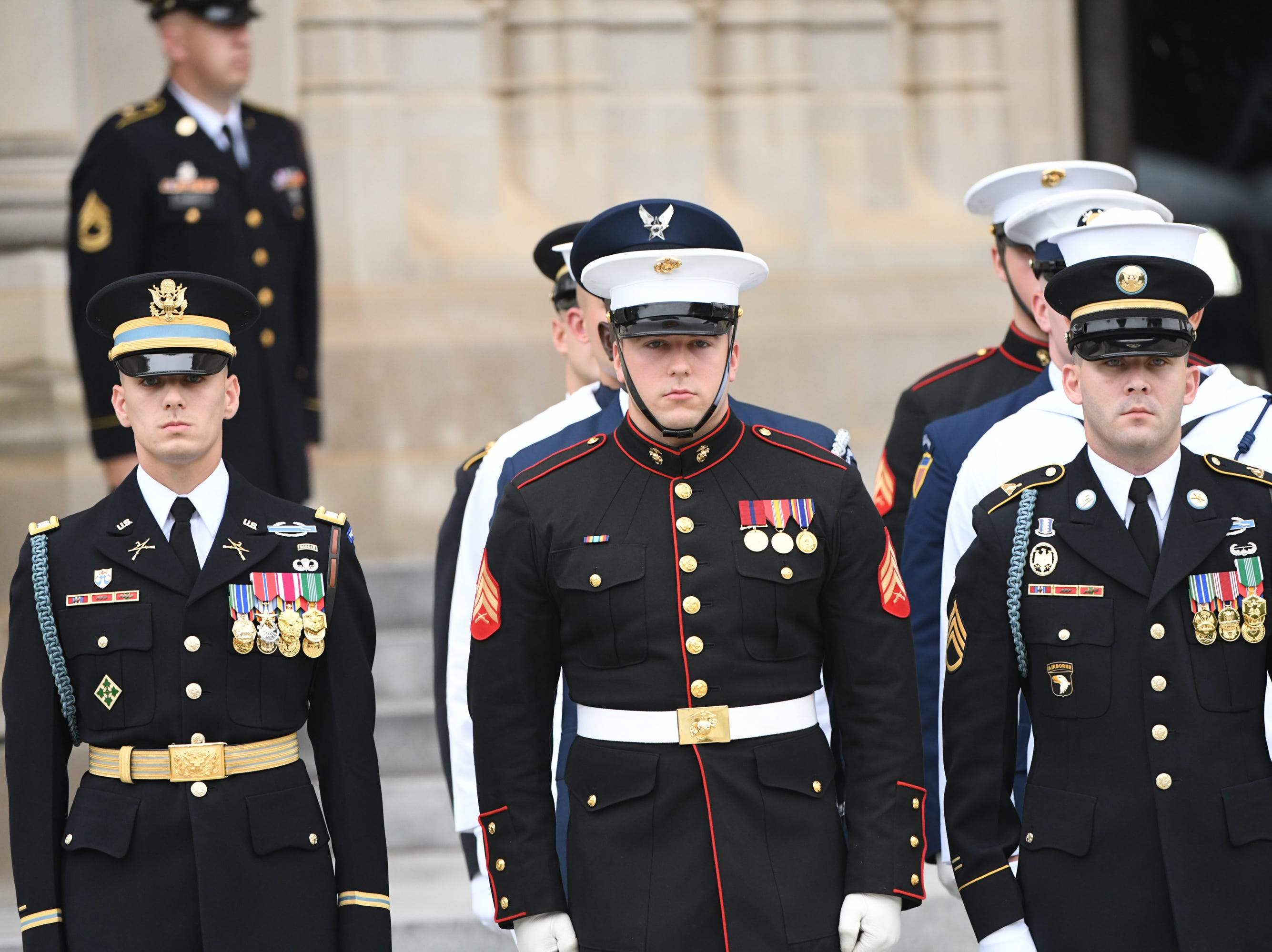 9/1/18 9:26:33 AM -- Washington, DC, U.S.A  -- Members of a military honor guard team await the arrival of John McCain's casket at the National Cathedral in Washington for a memorial service on Sept. 1, 2018. Sen. McCain died on Aug. 25. --    Photo by Jasper Colt, USA TODAY Staff