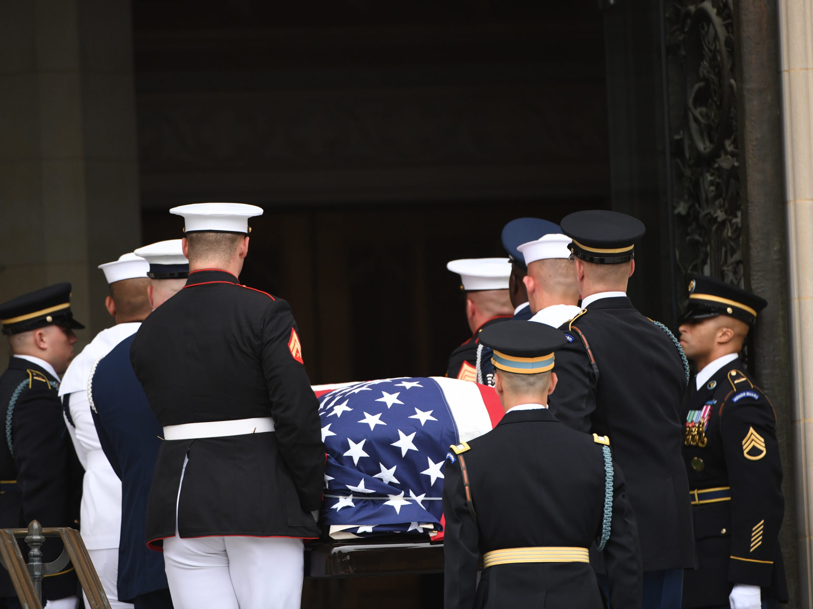 9/1/18 9:48:32 AM -- Washington, DC, U.S.A  -- The body of John McCain is carried into the National Cathedral in Washington for a memorial service on Sept. 1, 2018. Sen. McCain on Aug. 25. --    Photo by Jasper Colt, USA TODAY Staff