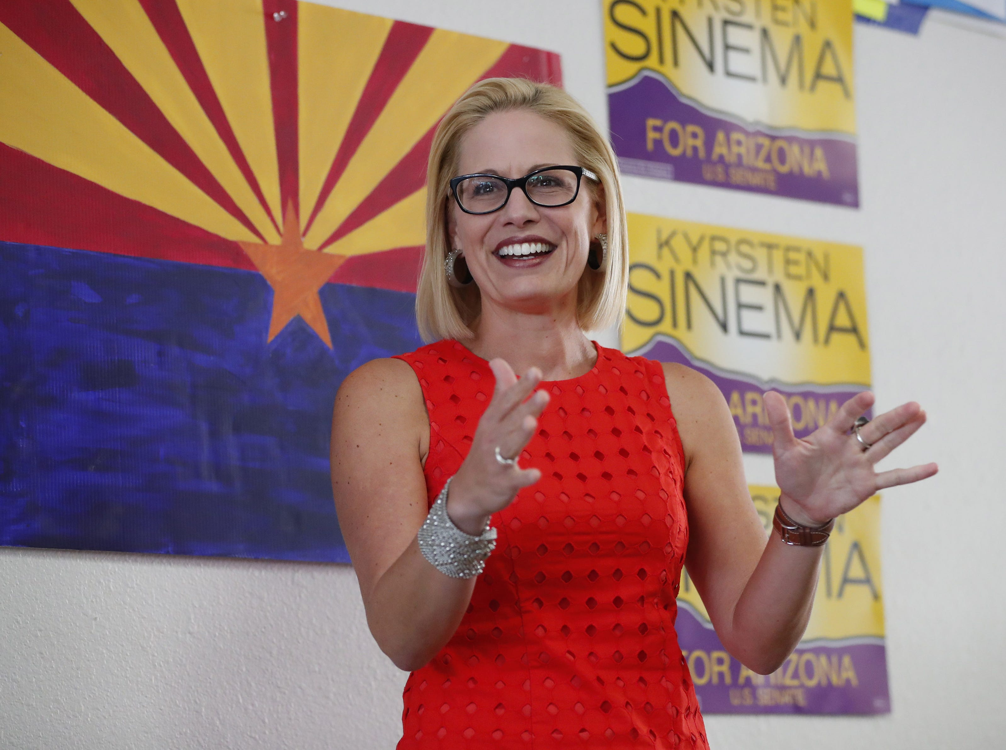 Kyrsten Sinema thanks volunteers Aug. 28. 2018, at her field office in Phoenix.