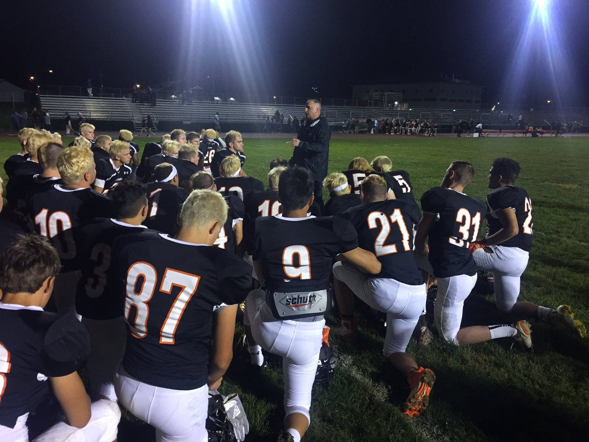 Palmyra coach Chris Pope meets with his team after a 31-10 win over Mechanicsburg in Week 2. The Cougars are off to a 3-0 start and Lebanon County's only remaining unbeaten football team.