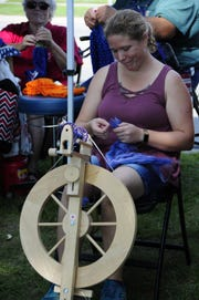 Sophie Derrick spins wool and silk into yarn at the Algonac Art Fair on Saturday, Sept. 1, 2018.