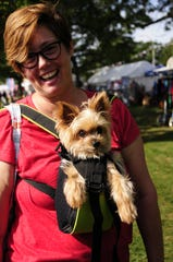Barbara Brooks gives Toby a ride at the Algonac Art Fair on Saturday, Sept. 1, 2018.