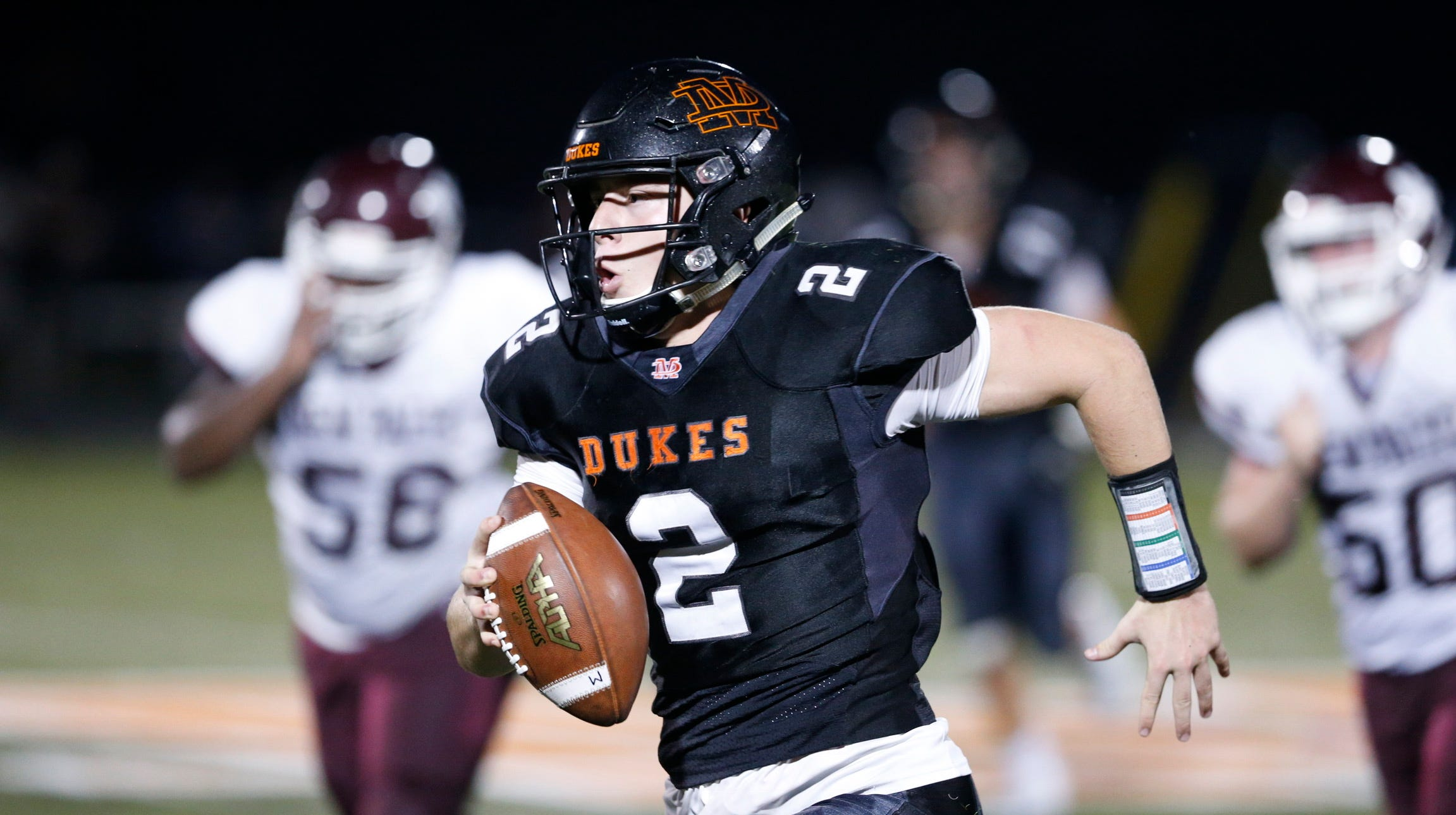 Marlboro's Sam Mongelli carries the ball in the second quarter during Friday's game versus New Paltz on Aug 31, 2018.