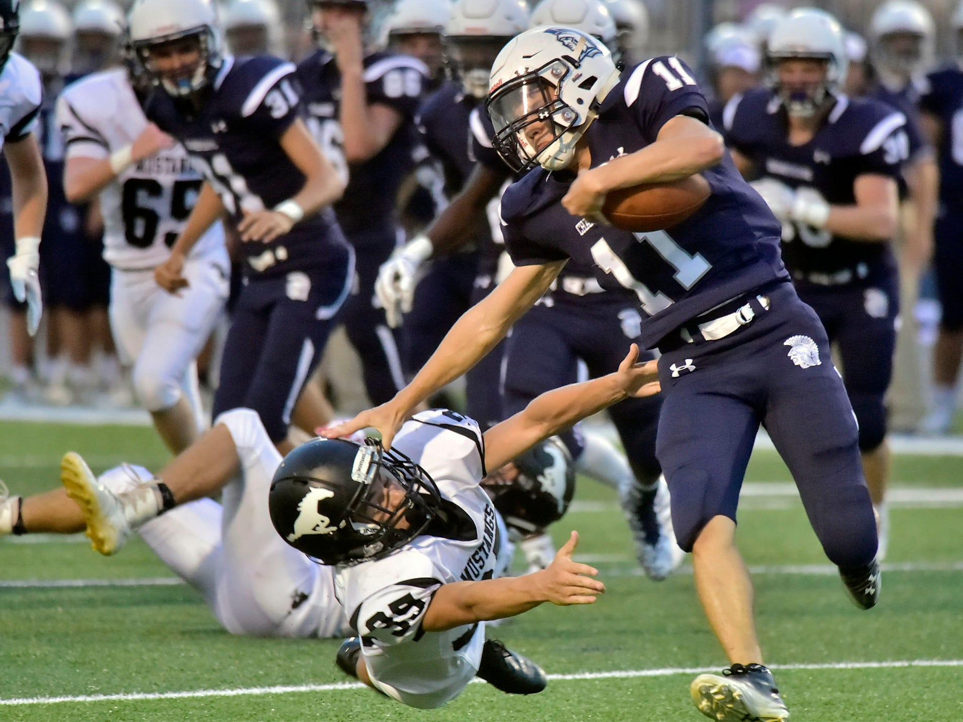 Chambersburg's Keaton Morris runs past South Western's Tyler Higdon for a first down. Chambersburg defeated South Western 51-26 in football on Friday, Aug. 31, 2018.