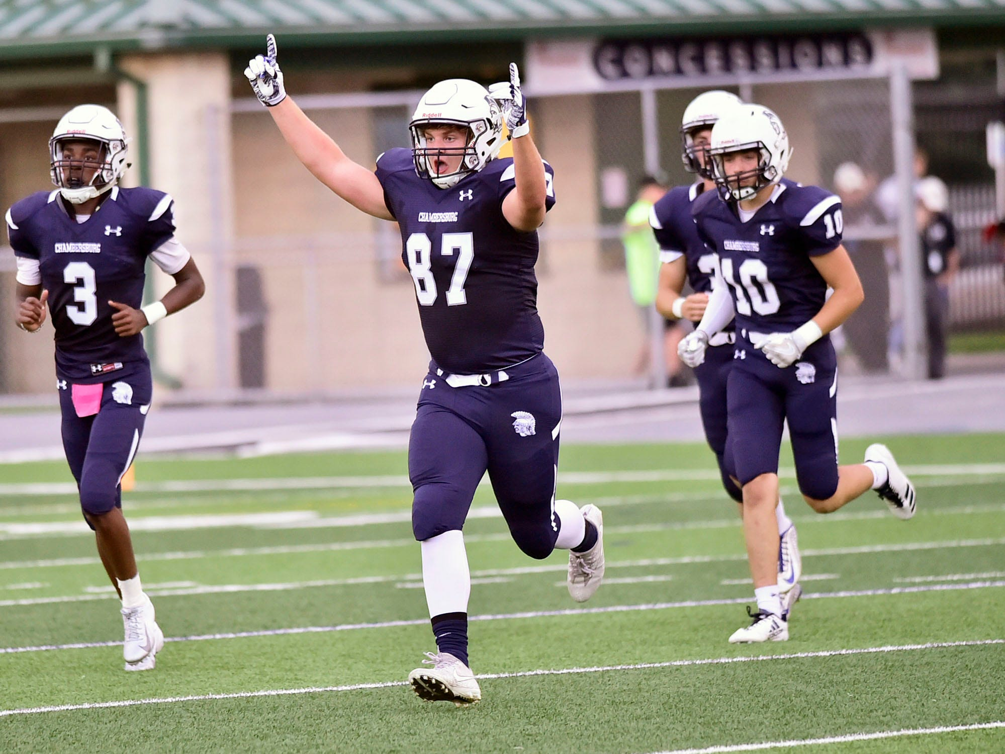Chambersburg's Bryce Diller (87) and teammates celebrate as the Trojans take the field. Chambersburg routed South Western 51-26 in football on Friday, Aug. 31, 2018.