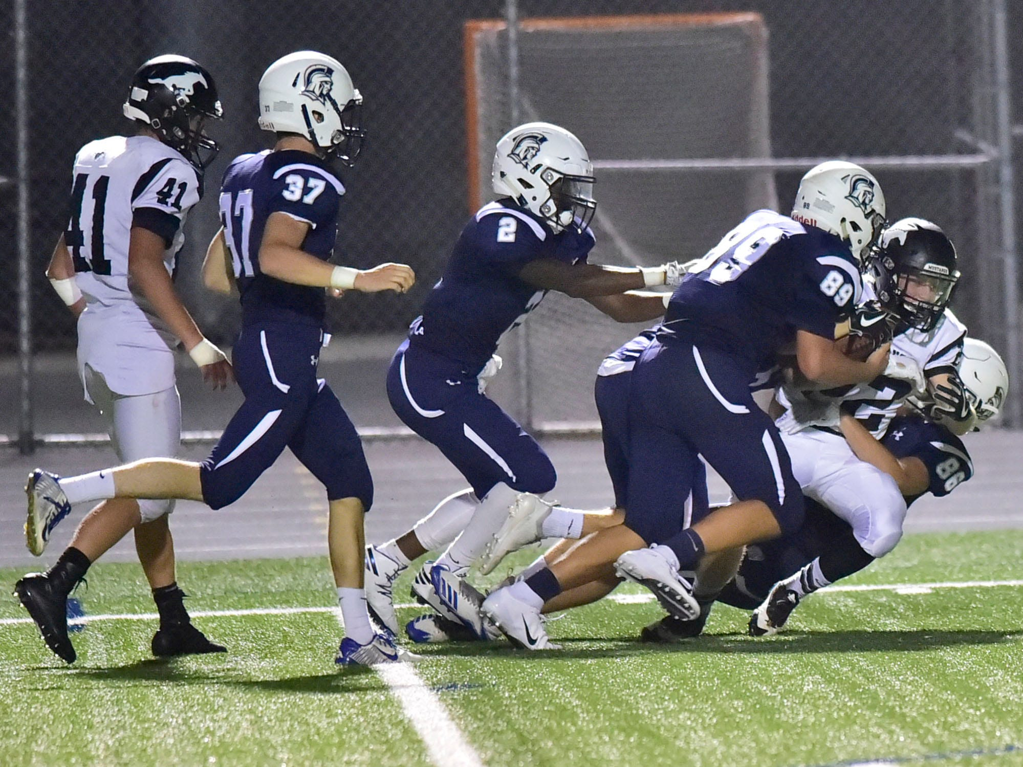 South Western's Aaron Fry, right, is met by a host of Chambersburg defenders. Chambersburg defeated South Western 51-26 in football on Friday, Aug. 31, 2018.