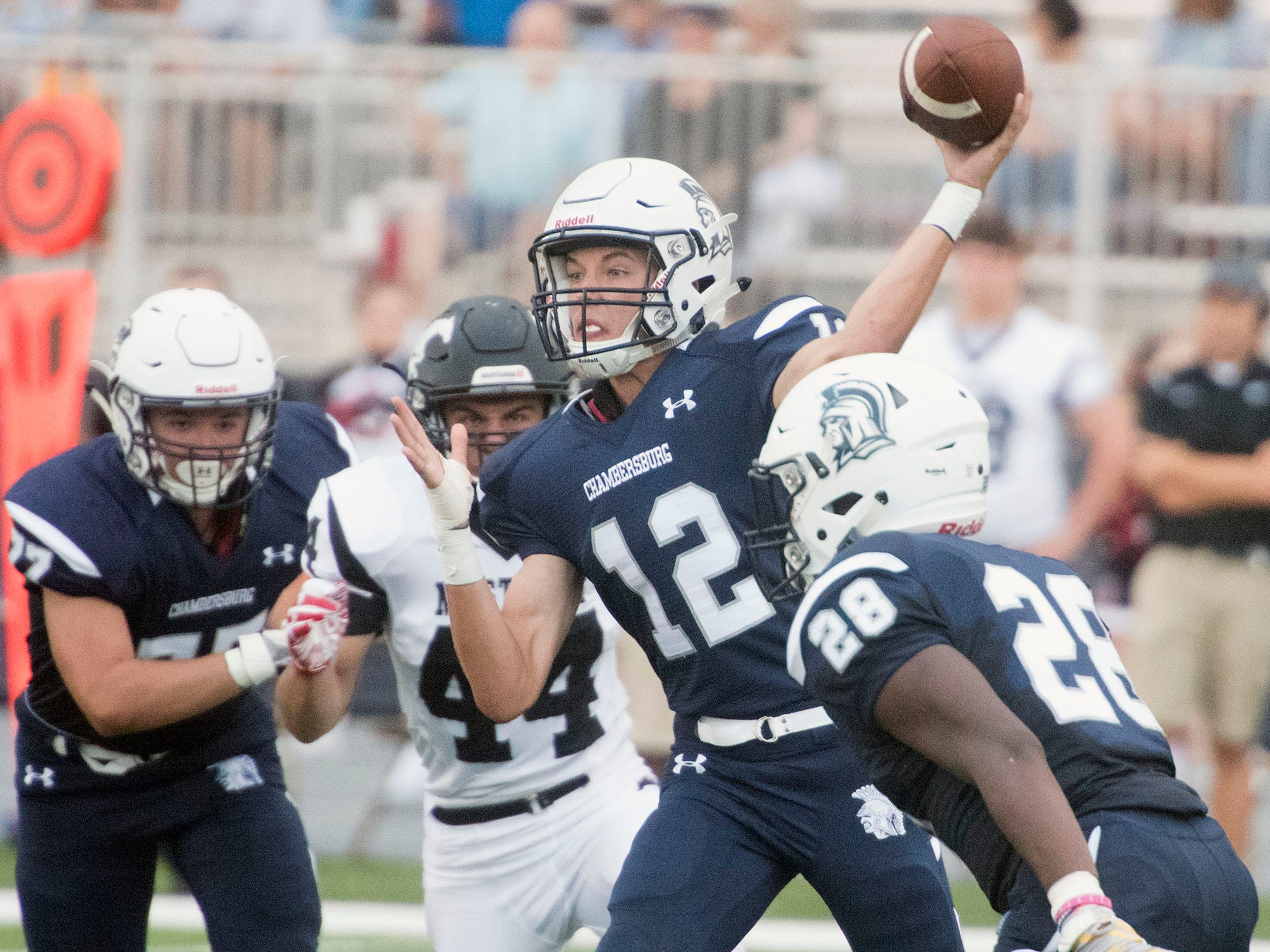 Chambersburg's Brady Stumbaugh drops back to pass for the Trojans. Chambersburg defeated South Western 51-26 in football on Friday, Aug. 31, 2018.