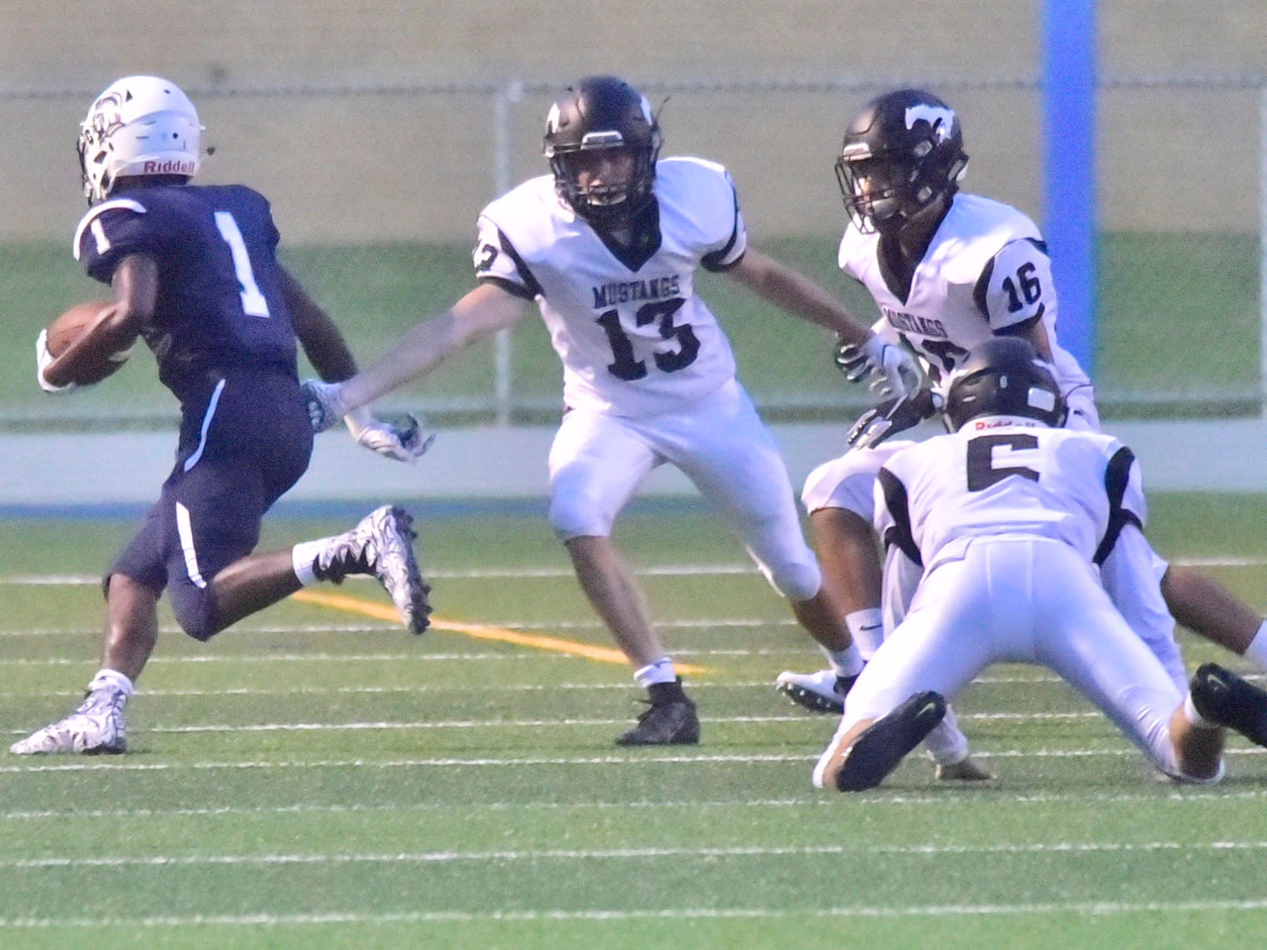 Chambersburg's Kevin Lee (1) gets away from South Western defenders to score. Chambersburg defeated South Western 51-26 in football on Friday, Aug. 31, 2018.