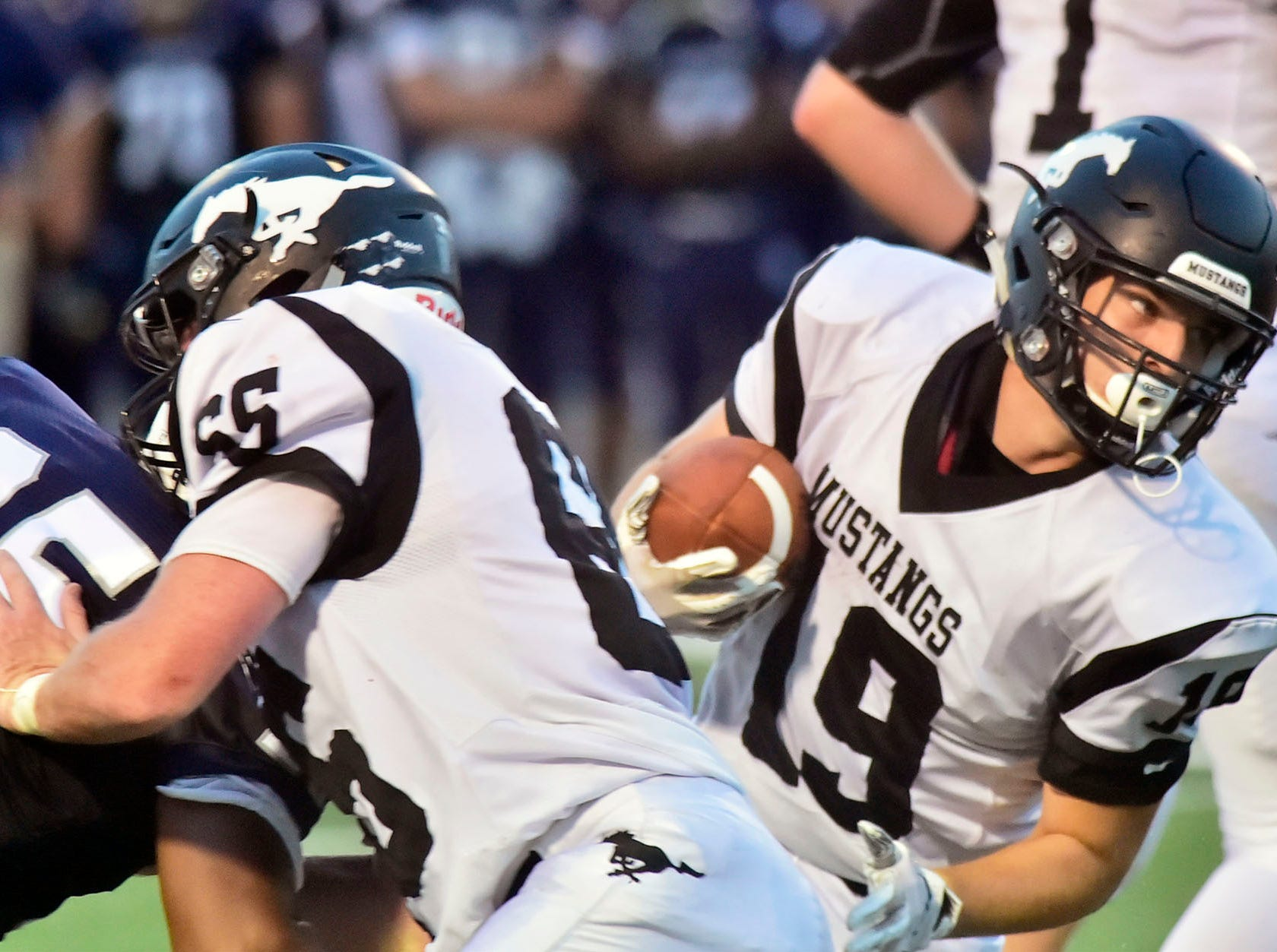 South Western's Nick Boone (19) runs the ball for the Mustangs. Chambersburg defeated South Western 51-26 in football on Friday, Aug. 31, 2018.