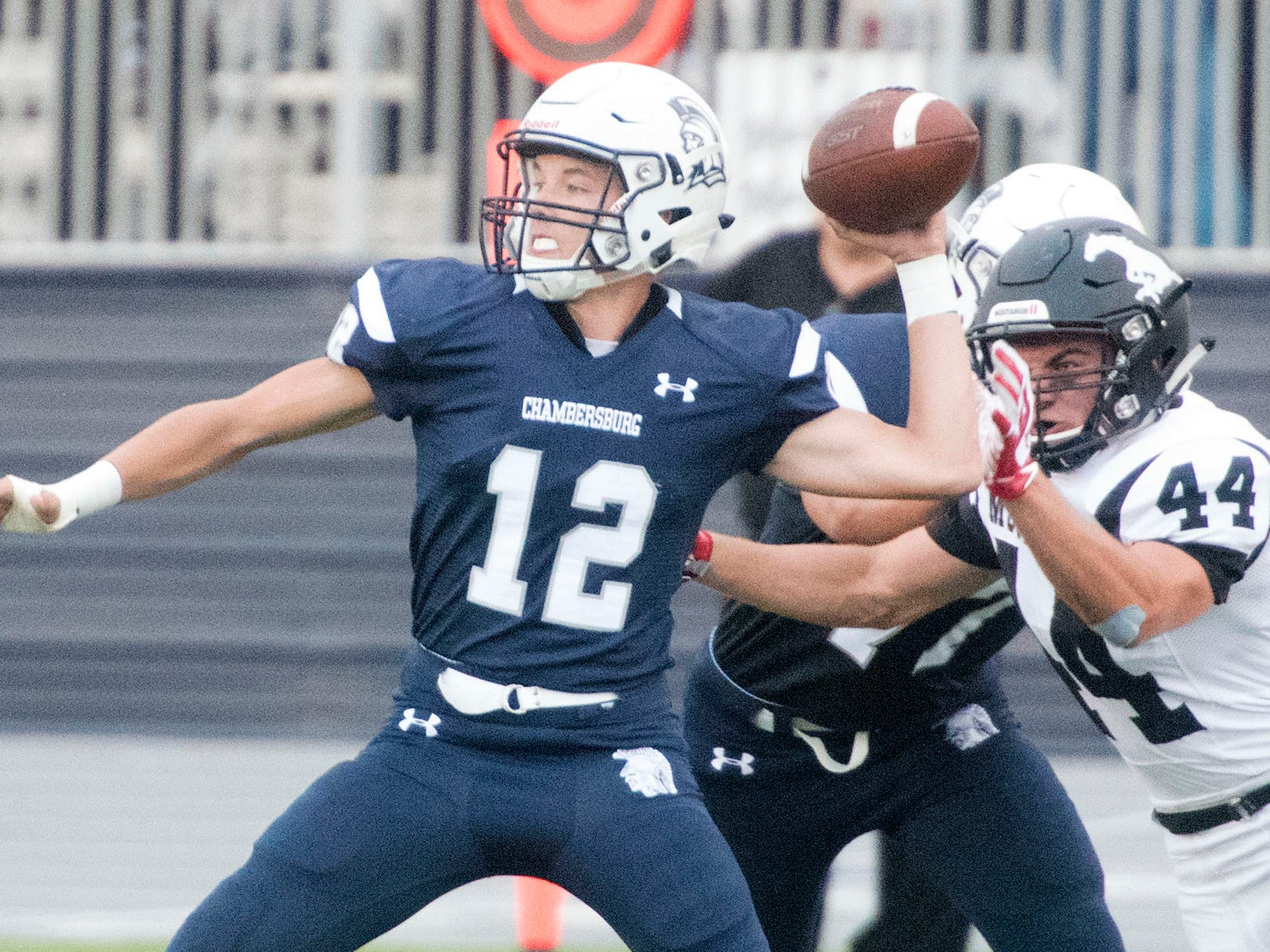 Chambersburg's Brady Stumbaugh drops back to pass while pressured by South Western's Ryan Sheehan (44). Chambersburg defeated South Western 51-26 in football on Friday, Aug. 31, 2018.