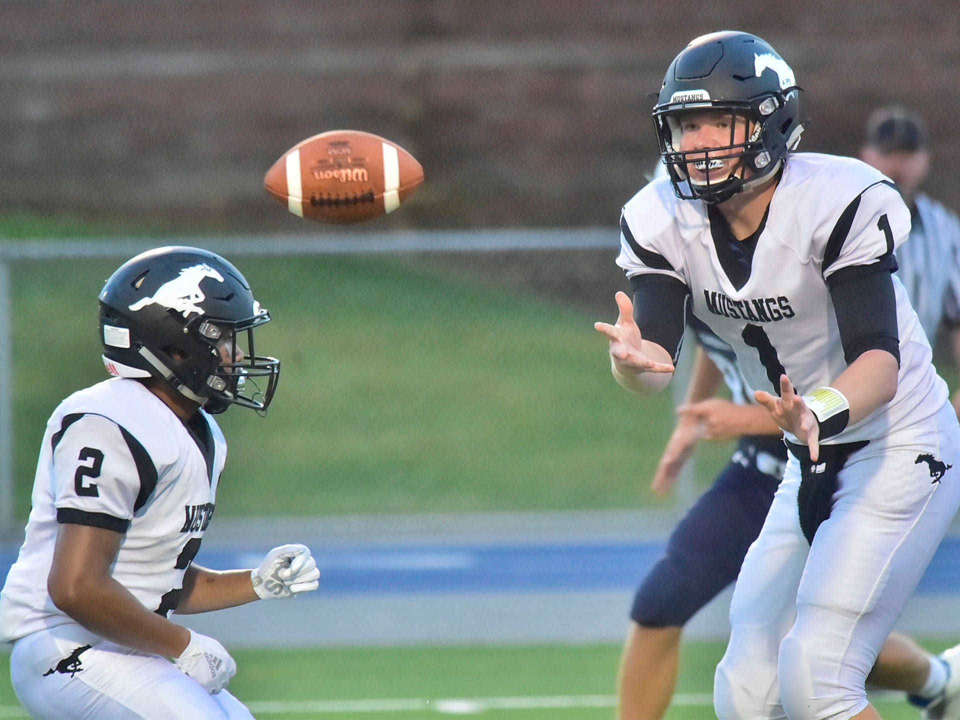 South Western quarterback Derek Huff pitches the ball to fullback Anthony Soriano. Chambersburg defeated South Western 51-26 in football on Friday, Aug. 31, 2018.