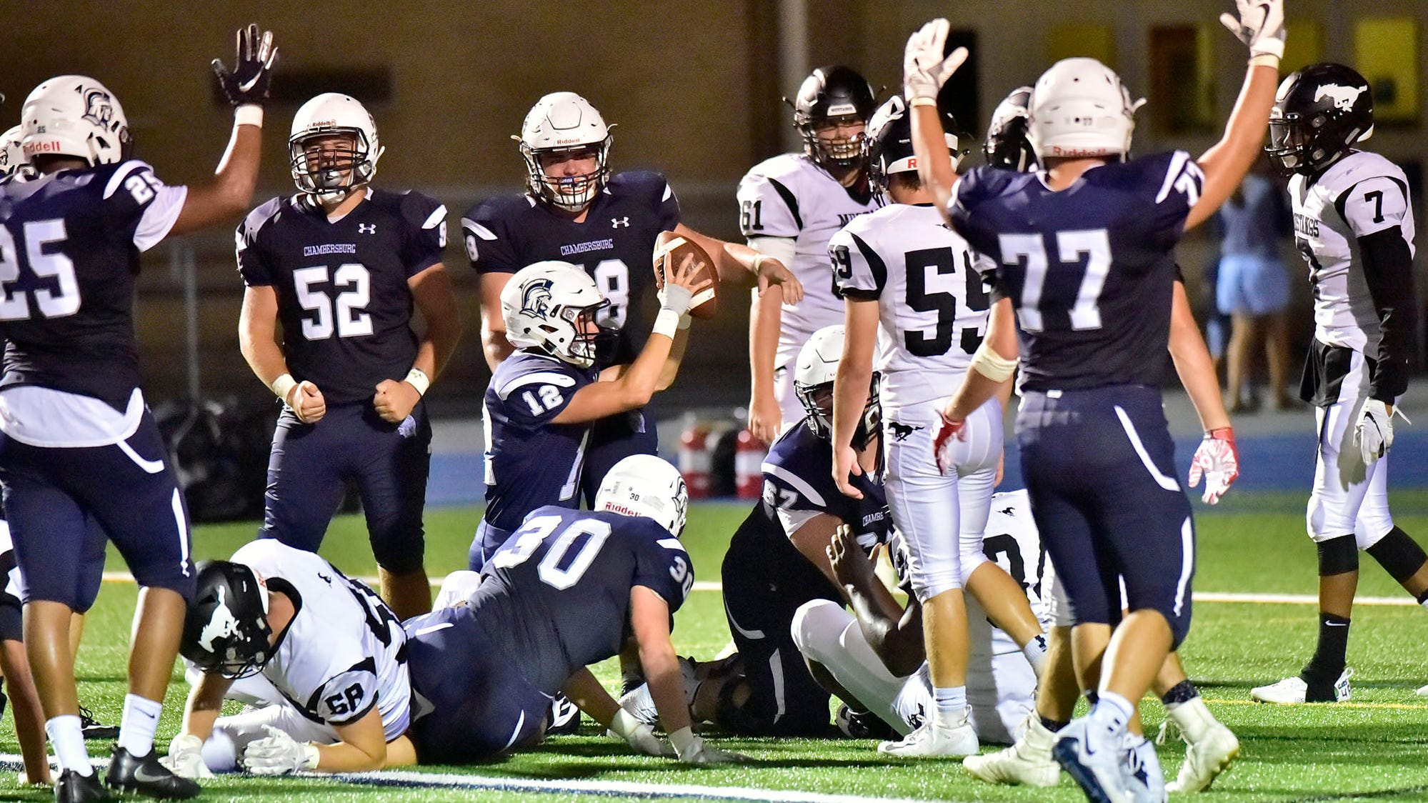 Chambersburg's Brady Stumbaugh (12) raises the ball after scoring on a keeper. Chambersburg routed South Western 51-26 in football on Friday, Aug. 31, 2018.