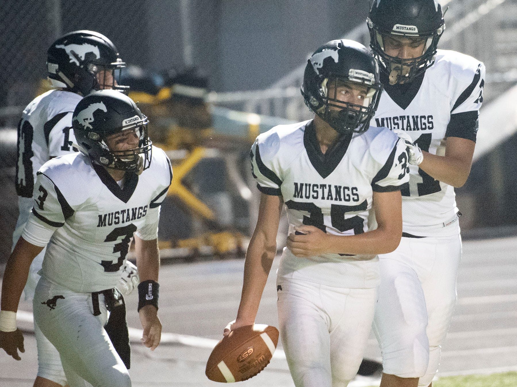 South Western's Tyler Higdon (35) celebrates a touchdown with Mustang teammates. Chambersburg defeated South Western 51-26 in football on Friday, Aug. 31, 2018.