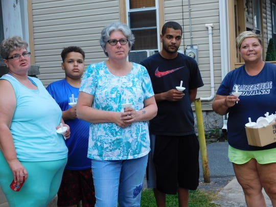 Residents Mary Stache, Chris Stache, Angela Cleary, Chris Reed and Stacy Short, before the vigil on Garber Street on Friday, Aug. 31, 2018. Residents participated in the vigil as part of an effort to bring safety back to their street, which has seen at least two gun-related incidents in just over a year.