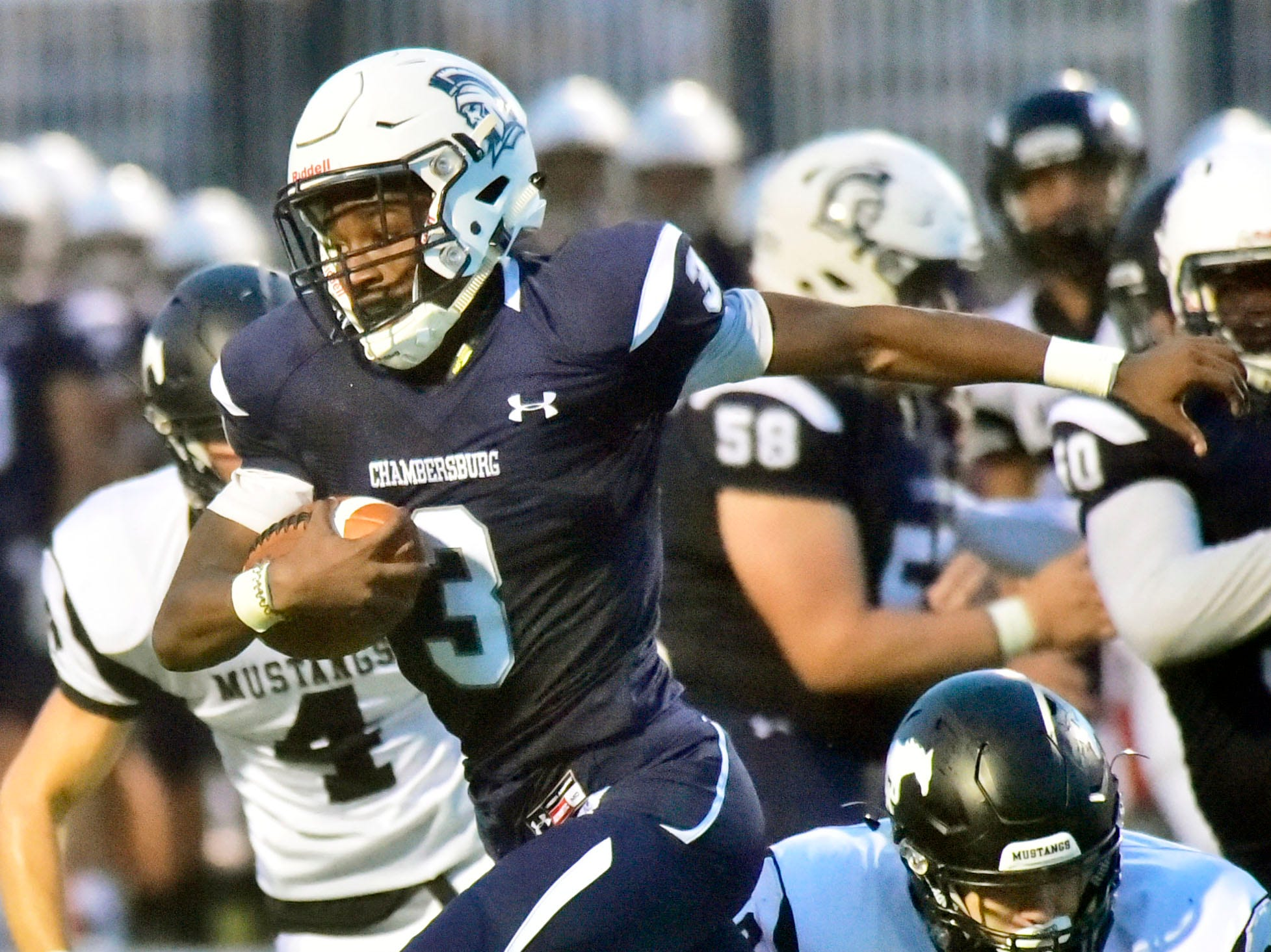 Chambersburg's Tyeshawn Worrell (3) returns the ball for the Trojans. Chambersburg defeated South Western 51-26 in football on Friday, Aug. 31, 2018.