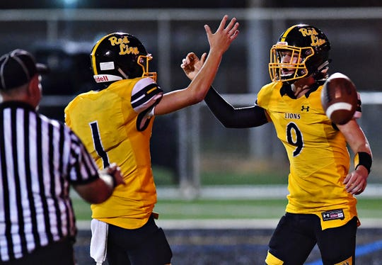 Red Lion's Randy Fizer, left, and Nic Shultz celebrate a touchdown made by Shultz against Waynesboro on Friday, Aug. 31, 2018. Red Lion travels to Chambersburg Friday. Dawn J. Sagert photo