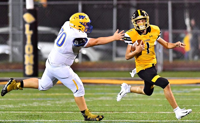 Red Lion's Randy Fizer, right, runs the ball while Waynesboro's Xavier Rhyne defends during football action at Horn Field in Red Lion, Friday, Aug. 31, 2018. Red Lion would win the game 48-14. Dawn J. Sagert photo