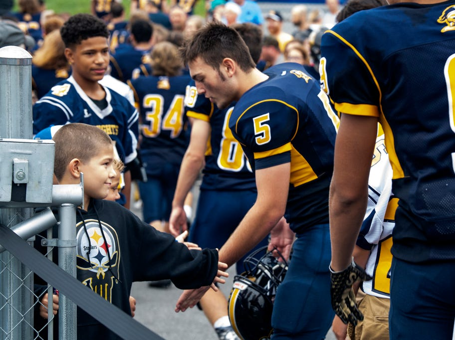 Young Eastern York fans high five Golden Knight players after the game, Saturday, September 1, 2018. The Eastern York Golden Knights (2-0) beat the Hanover Nighthawks (0-2) 47-21, at Eastern York High School.