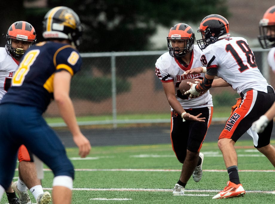Hanover quarterback Sam Duvall (18) hands the ball off to Fabian Lara (22), Saturday, September 1, 2018. The Eastern York Golden Knights (2-0) beat the Hanover Nighthawks (0-2) 47-21, at Eastern York High School.