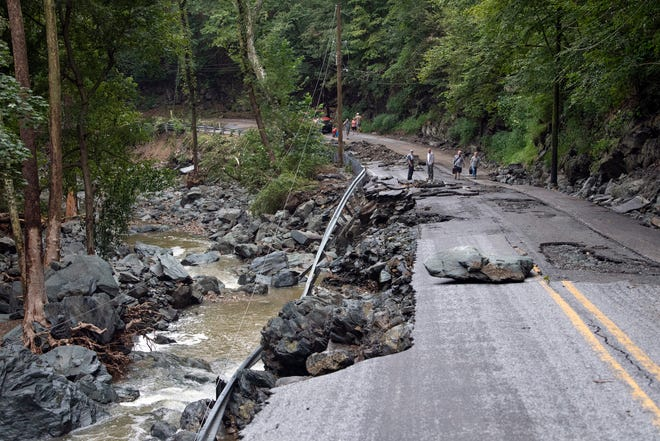 Floods took out parts of Accomac Road, in Hellam Township, and brought many power lines down with it as well, Saturday, September 1, 2018. Heavy rains flooded on Friday night flooded much of York County, leaving many roads closed and some destroyed.